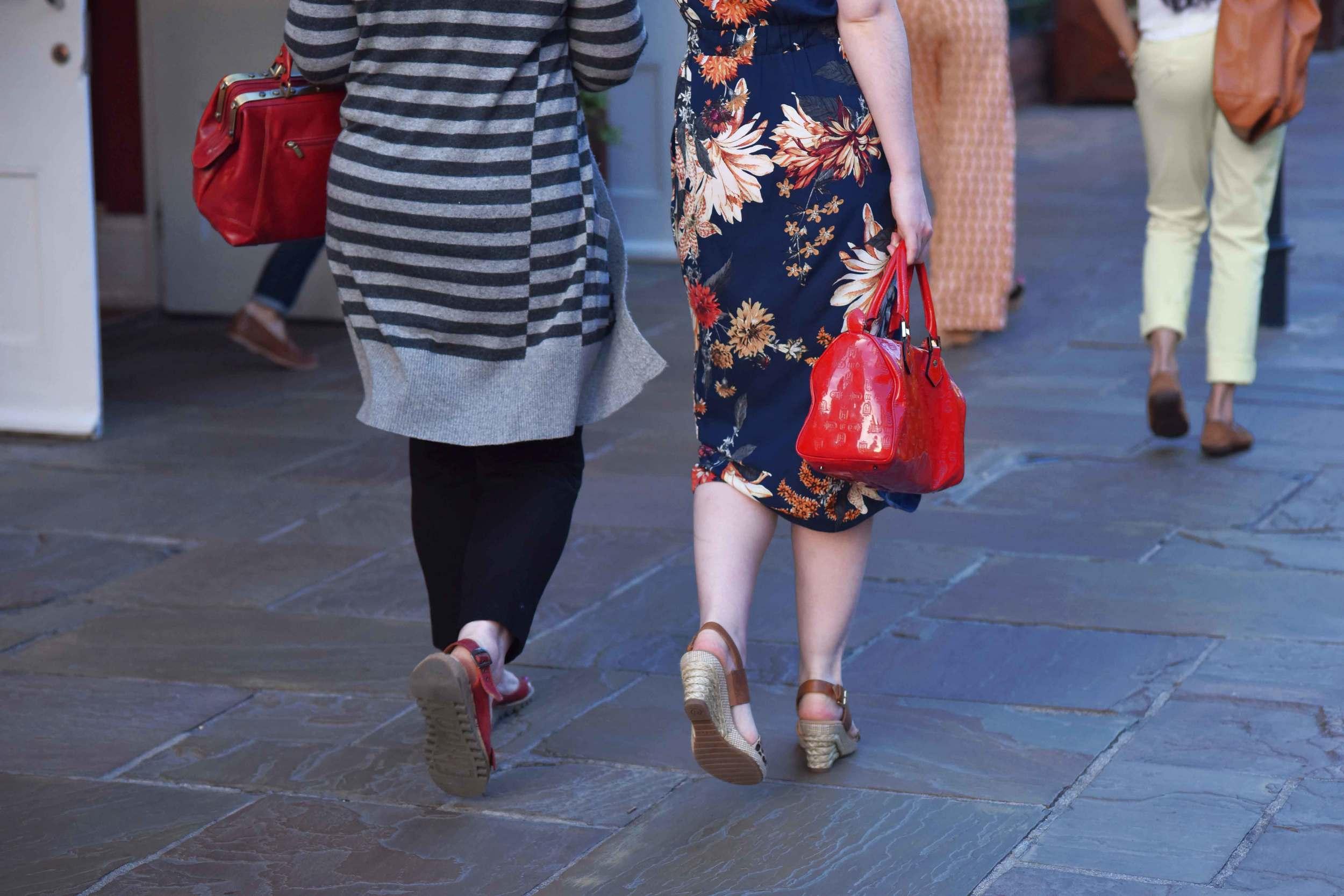 Spotted! Red bag is in vogue! Bicester village, designer shopping outlet near London, UK. Image©sourcingstyle.com