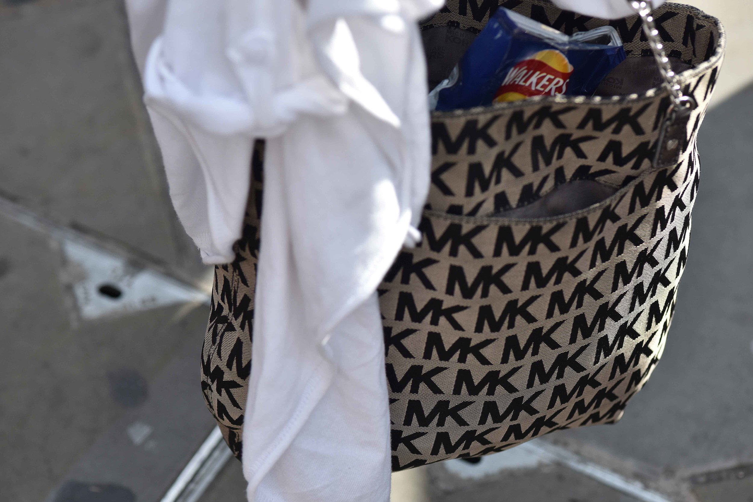 Michael Kors tote, MK all over design, clicked at Westminster Abbey, London, U.K. Image©sourcingstyle.com