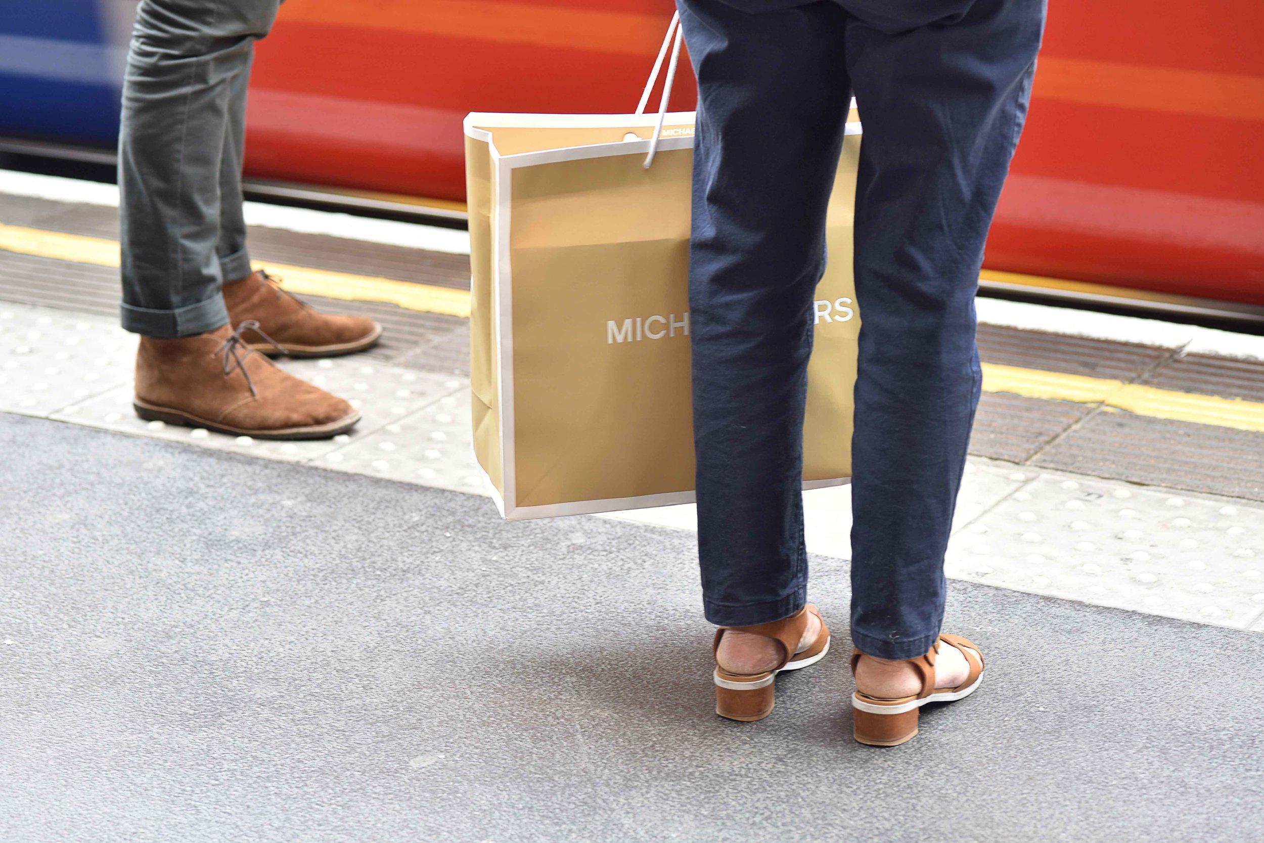 Michael Kors shopping bag, London tube, London, U.K. Image©sourcingstyle.com