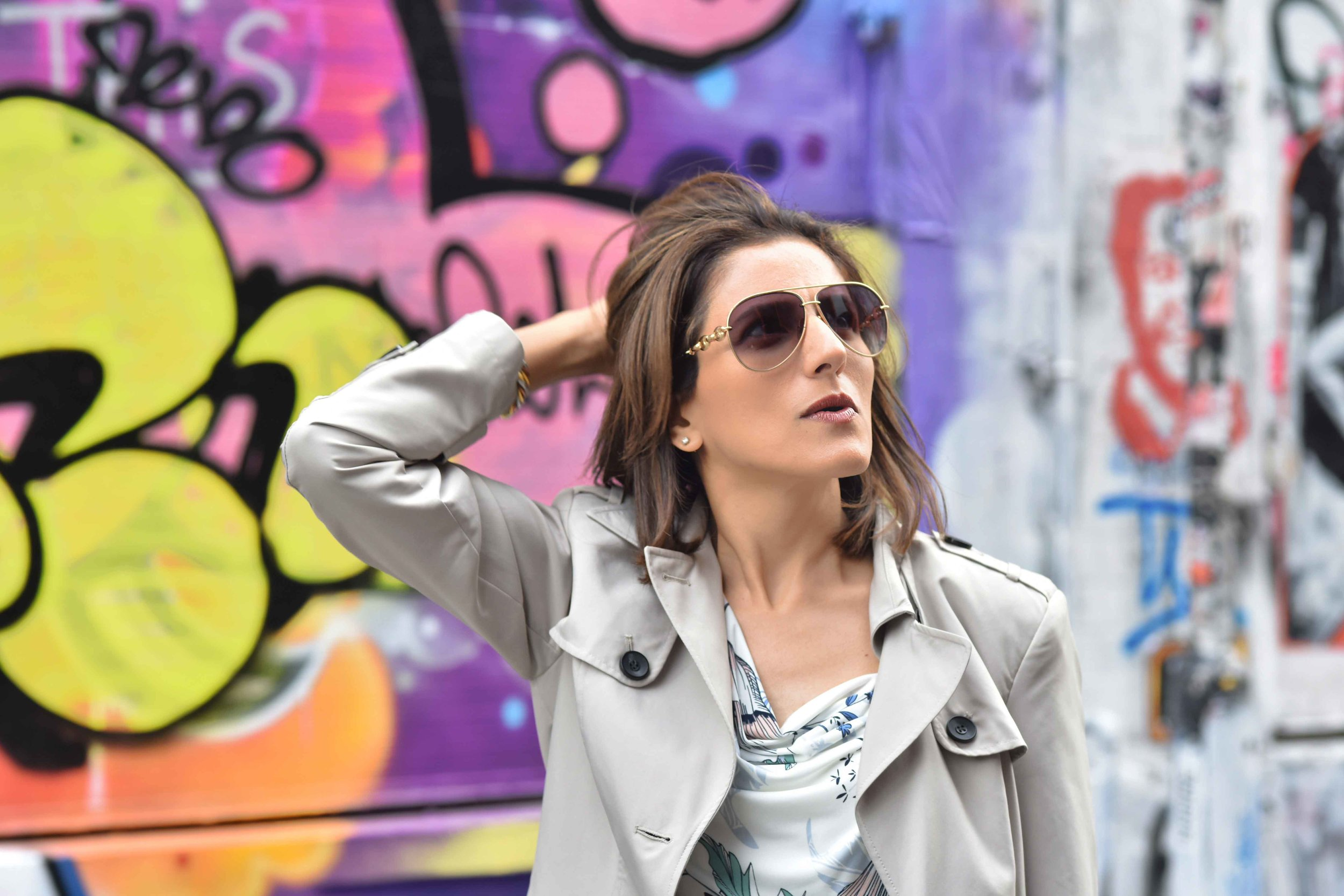 Marks and Spencer shift dress, Marks and Spencer trench, Gucci sunglasses, graffiti street art, street fashion, Shoreditch, London, U.K. Photo: Nina Shaw, Image©sourcingstyle.com