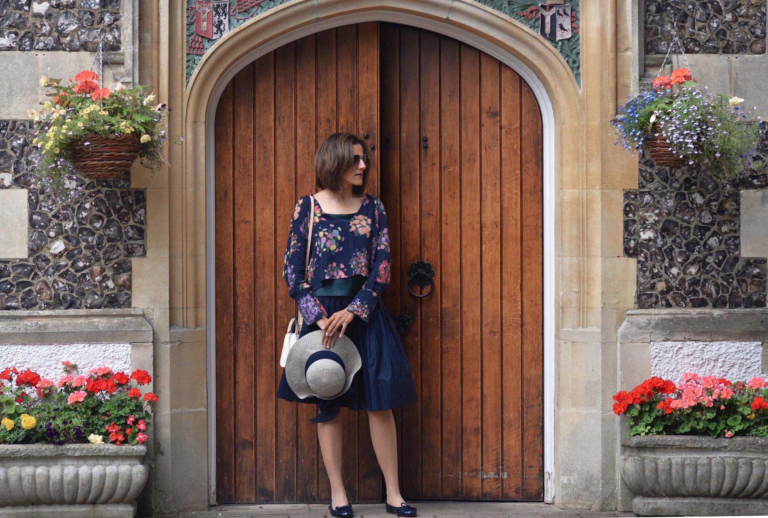 Zara floral top, Talbots silk Taffeta skirt, Talbots silk camisole, Prada ballet flats, M&S hat, Michael Kors bag. Image©sourcingstyle.com