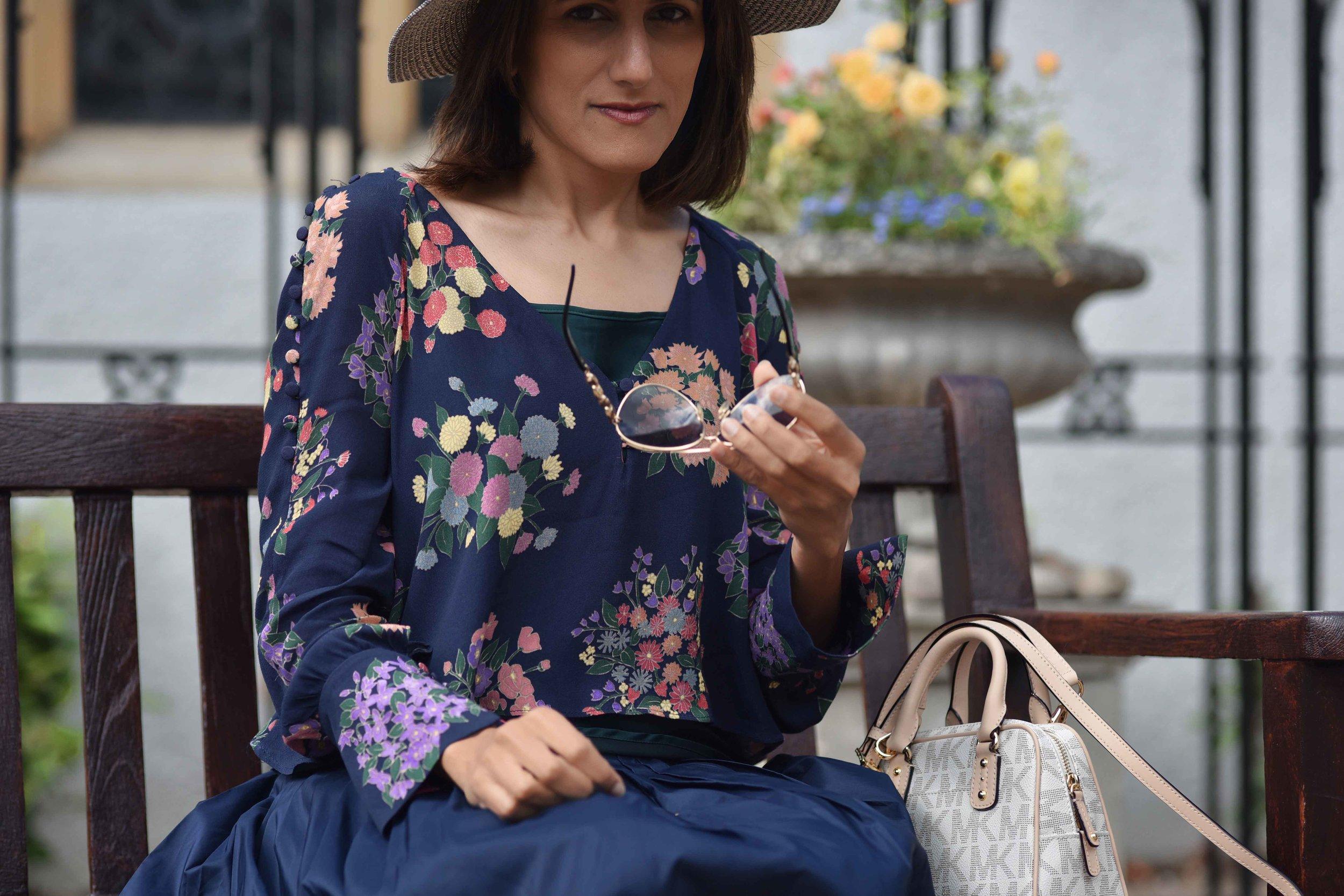 Zara floral top, Talbots silk Taffeta skirt, Talbots silk camisole, Michael Kors bag, M&S hat. Image©sourcingstyle.com