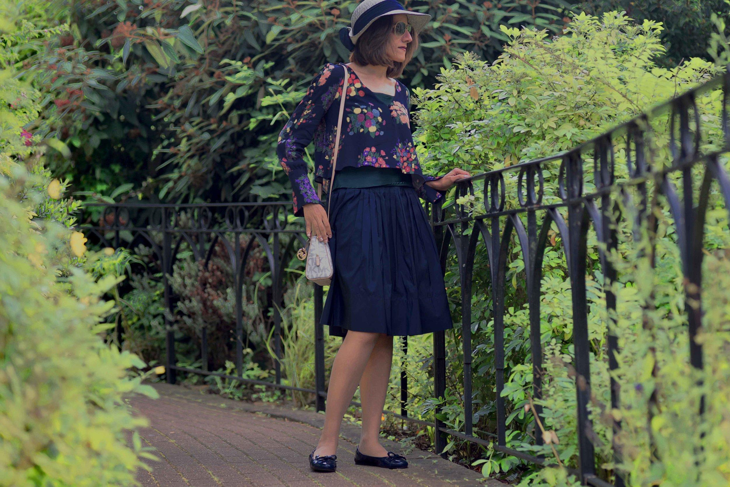 Zara floral top, Talbots silk Taffeta skirt, Talbots silk camisole, Michael Kors bag, Prada ballet flats, M&S hat. Image©sourcingstyle.com