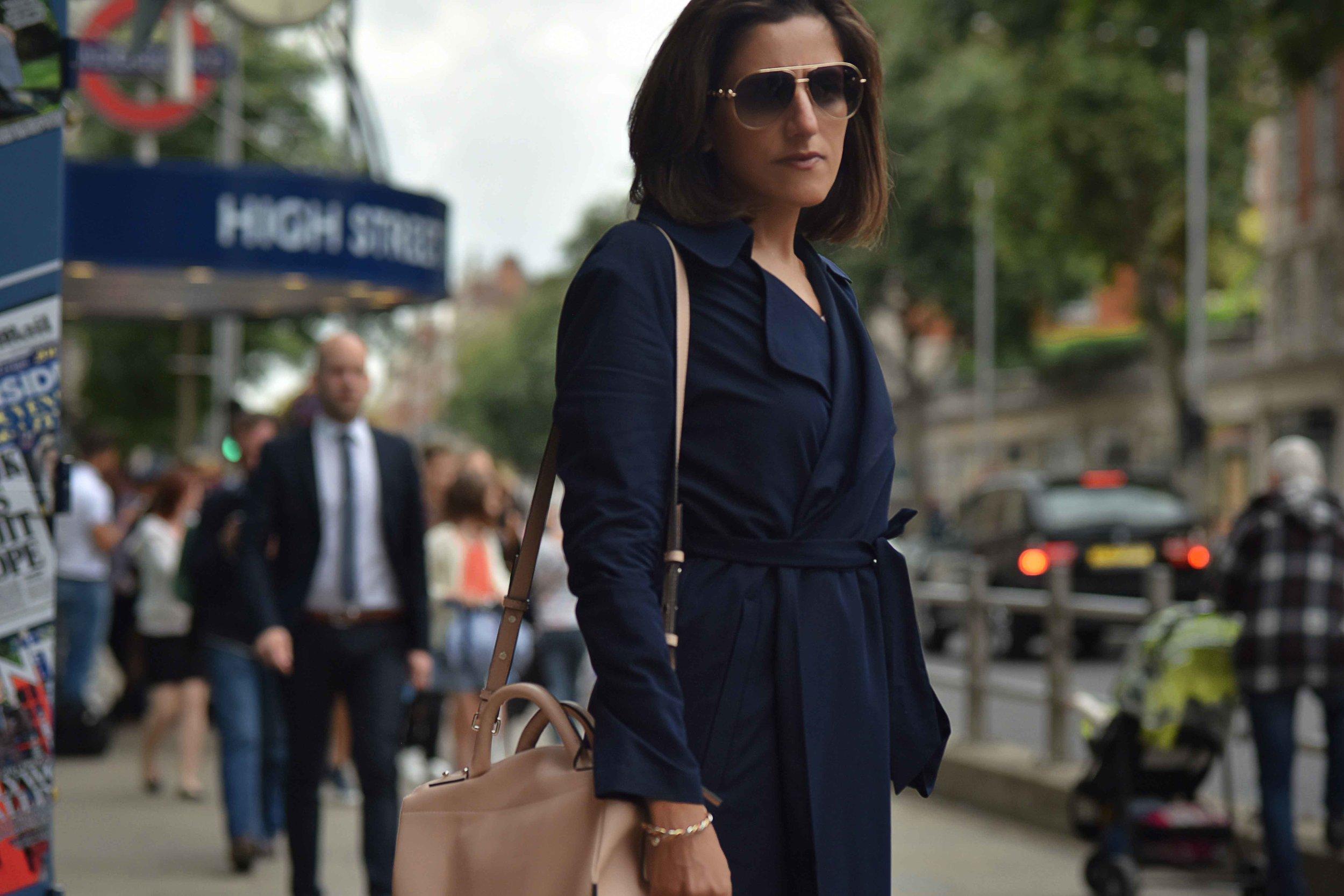 Marks & Spencer trench coat, Karen Millen bag, Gucci sunglasses, High Street Kensington, London. Image©sourcingstyle.com