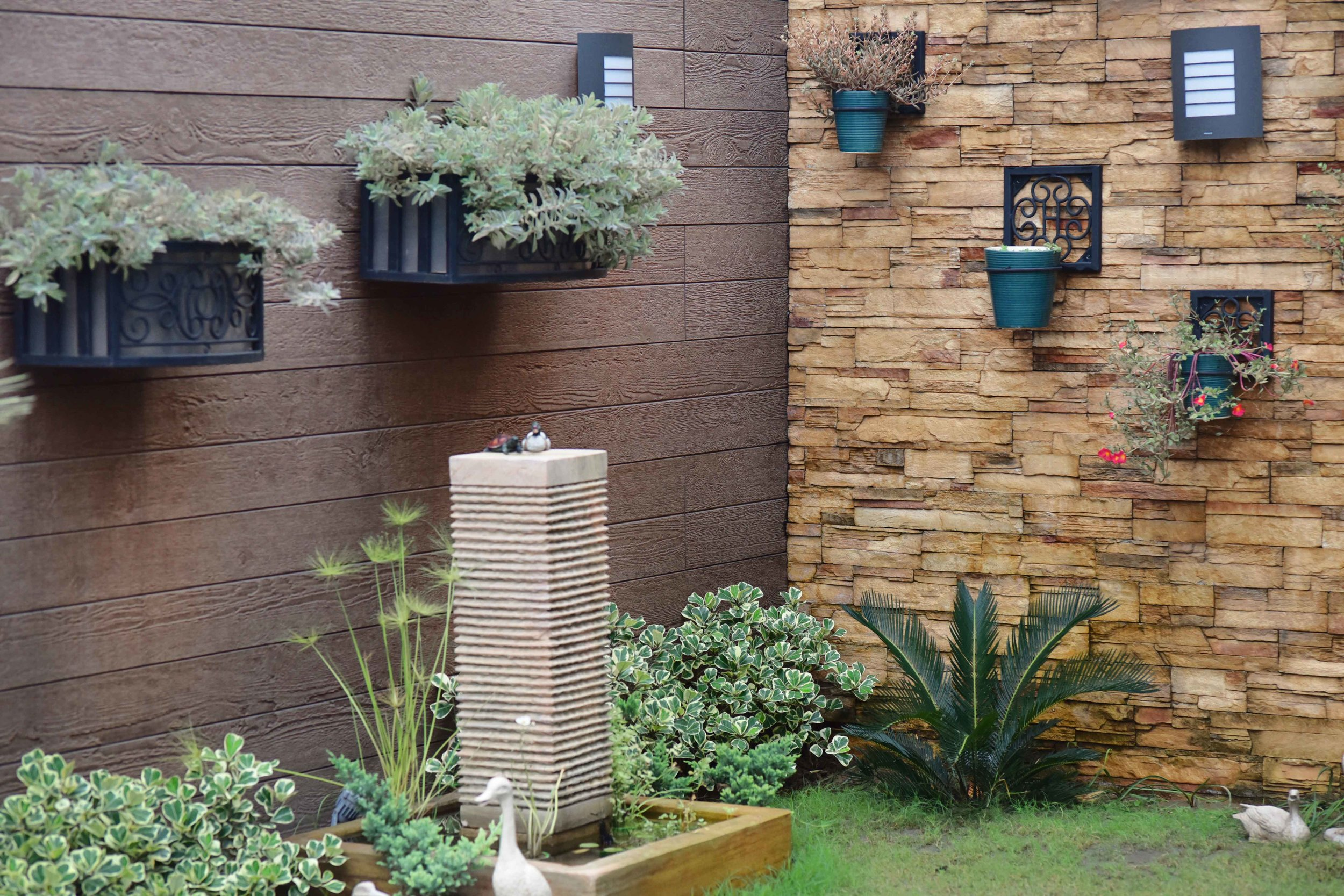 Landscape design by Geeta Singh, wall tiles, wall planters, water fountain. Image©sourcingstyle.com