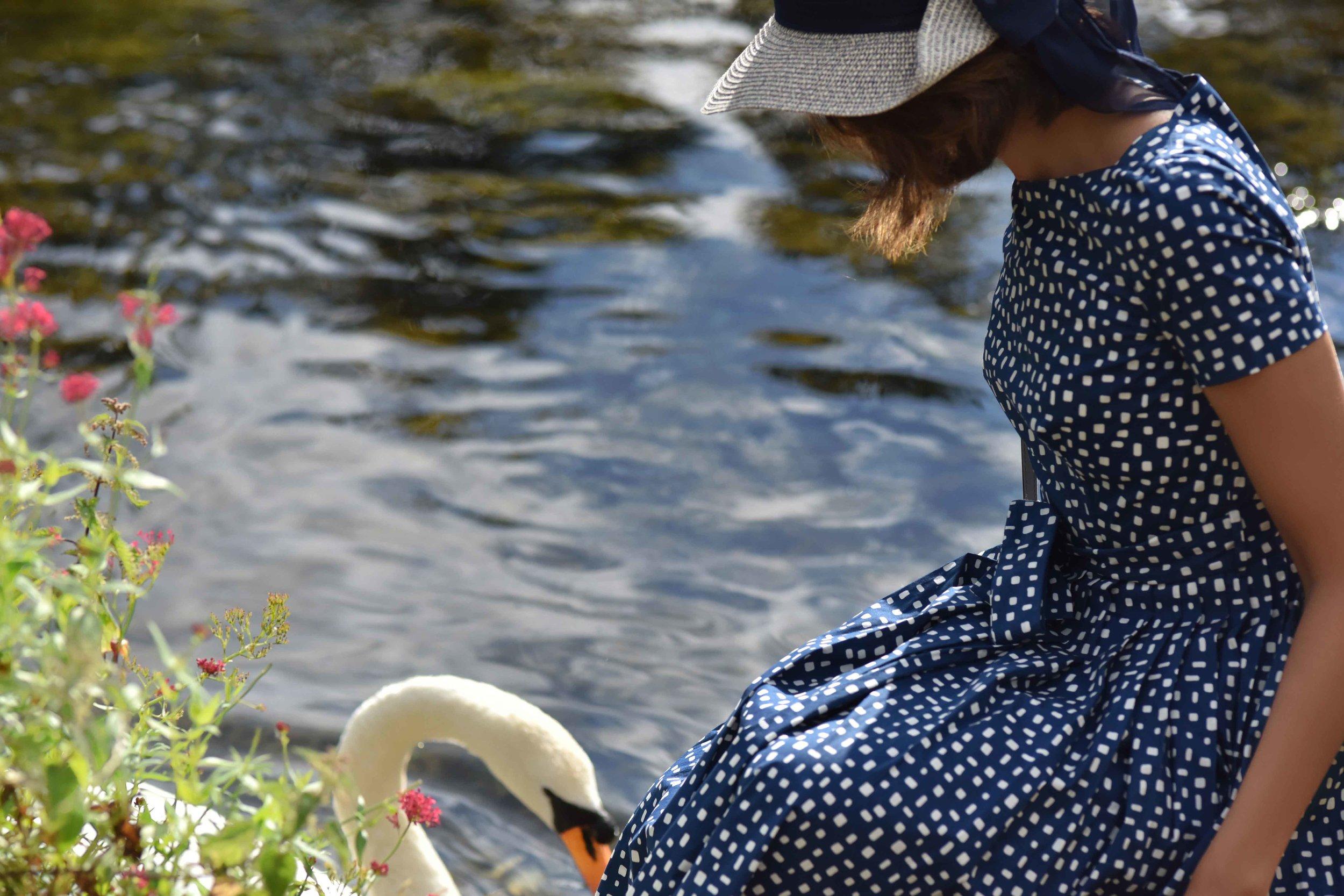 Prada dress, River Coln, Bibury, Cotswold, England. Image©sourcingstyle.com
