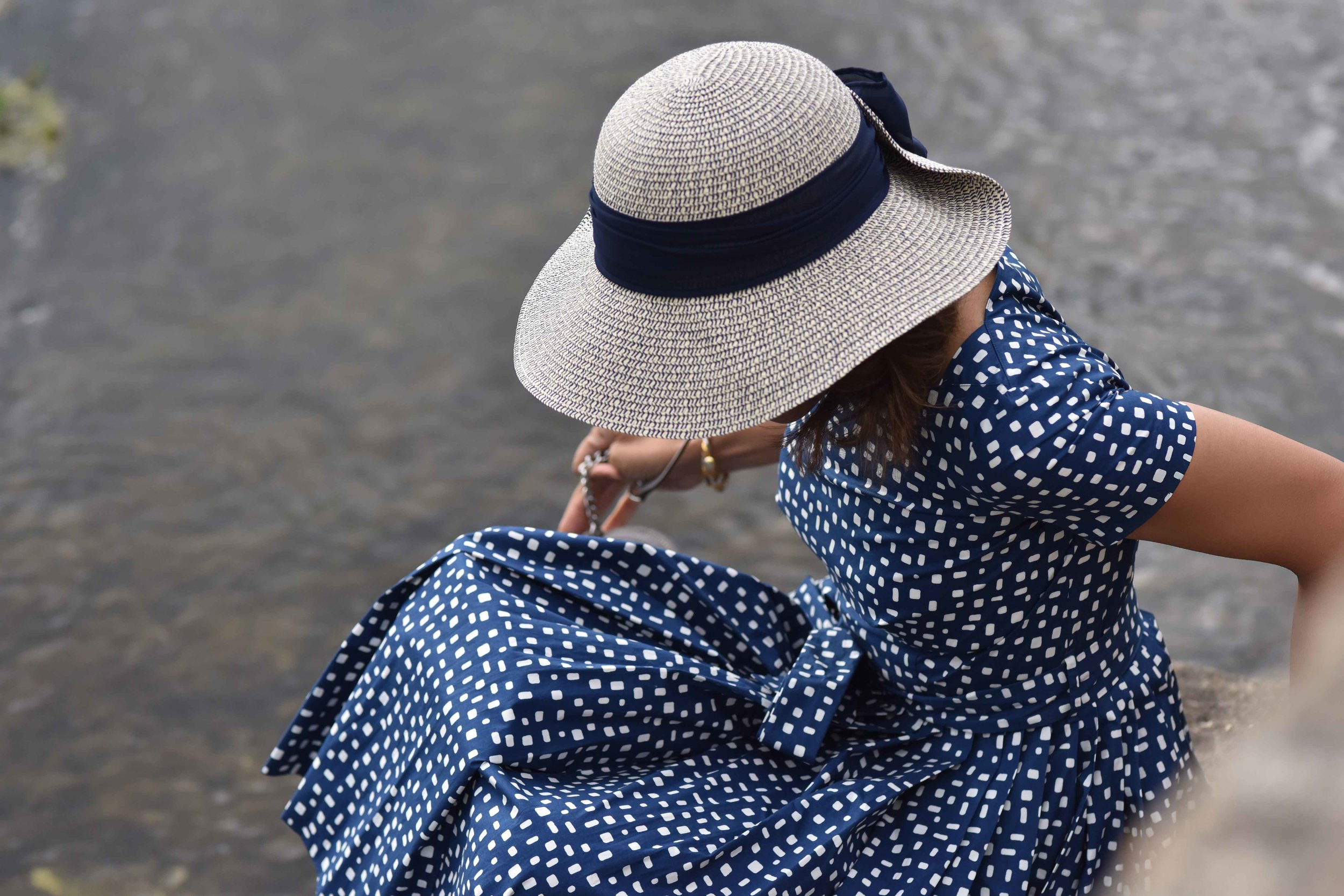Prada dress, MNS hat, River Coln, Bibury, Cotswold, England. Image©sourcingstyle.com