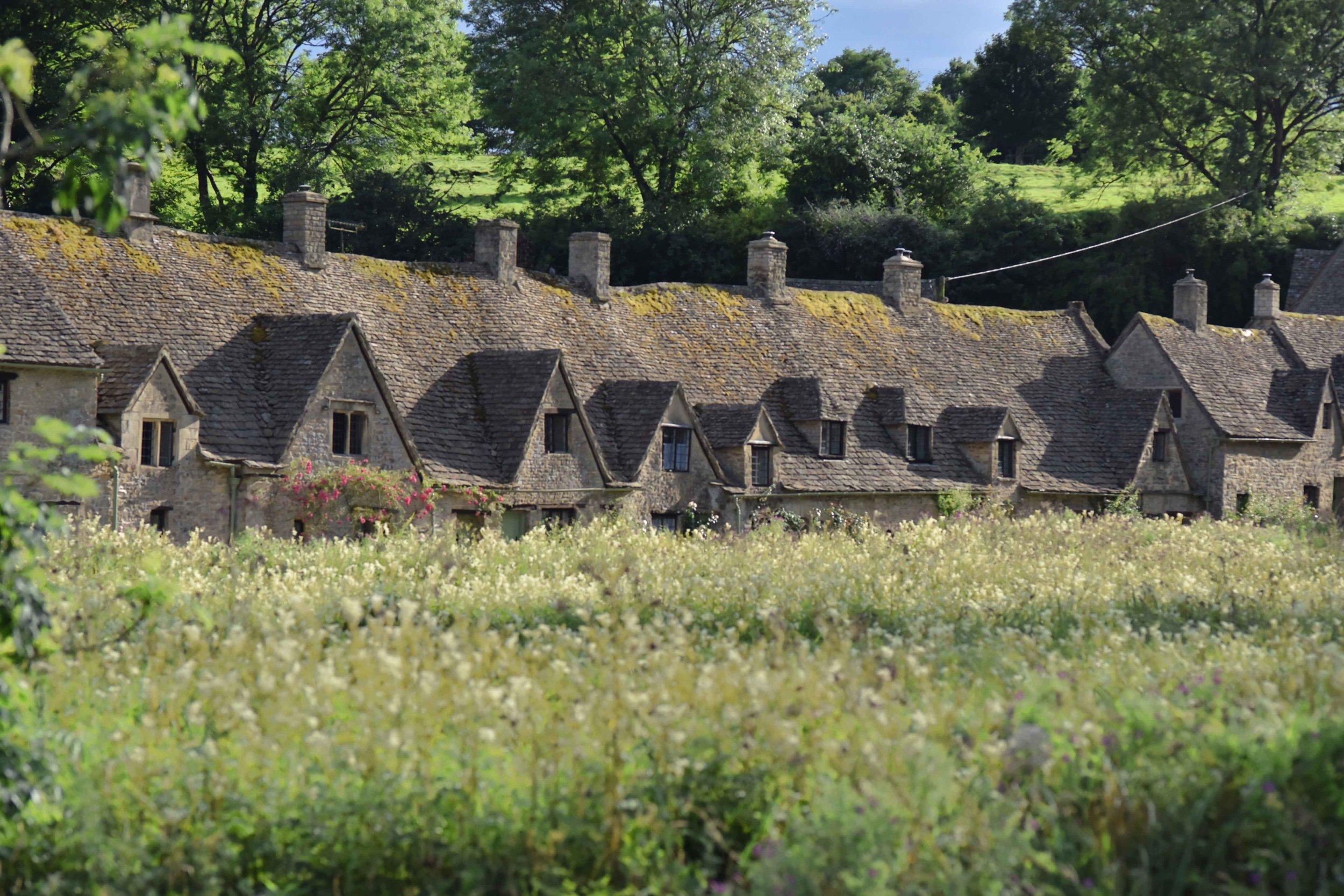 Cotswold stone cottages, Arlington Row, Bibury, Cotswold, England. Image©sourcingstyle.com