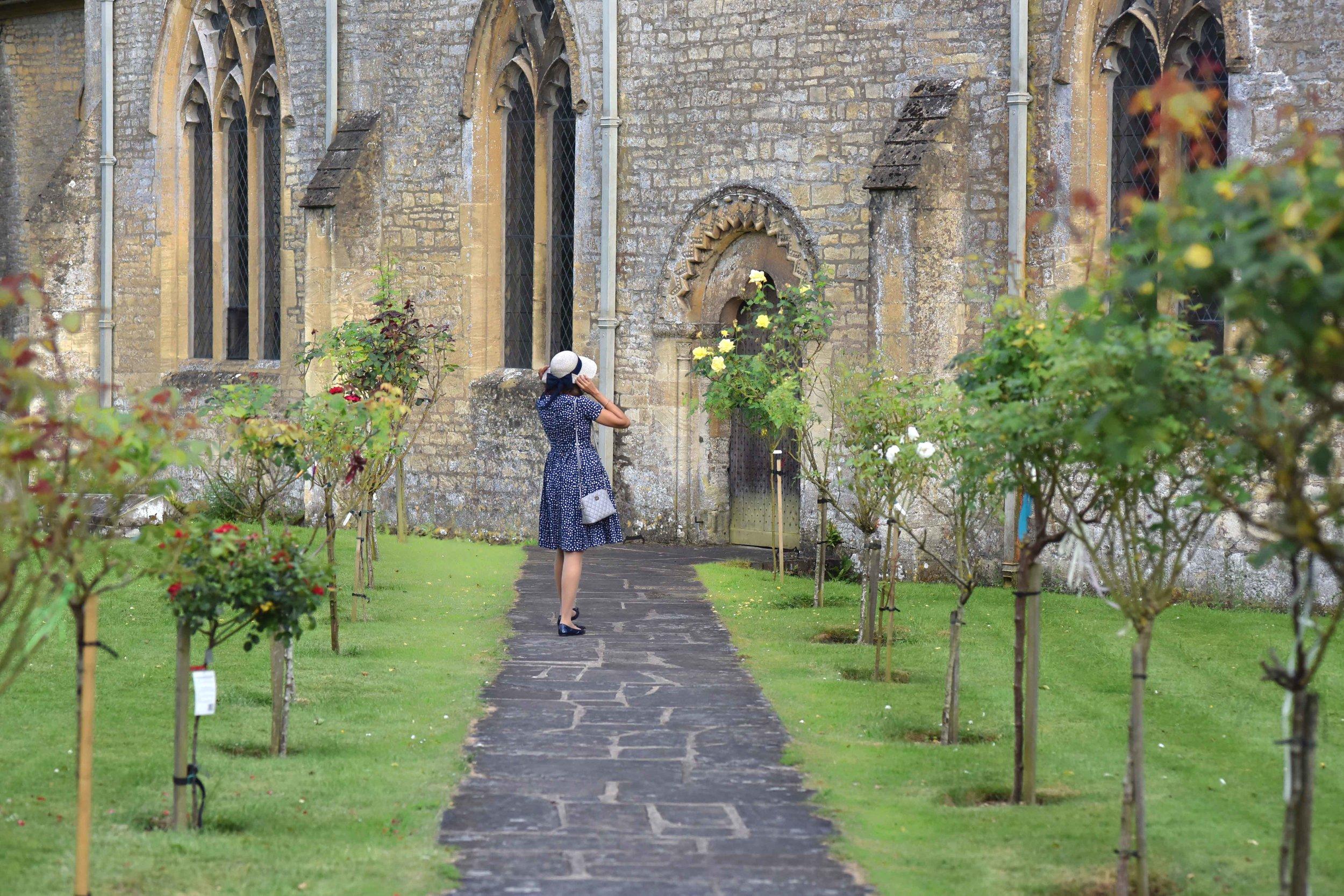 Prada dress, Saint Mary's church, Bibury, Cotswold, England. Image©sourcingstyle.com