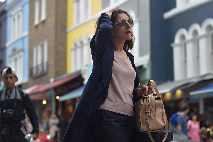 Marks & Spencer trench coat, Marks & Spencer knit top, Karen Millen bag, Notting Hill, Portobello Road, London. Image©sourcingstyle.com