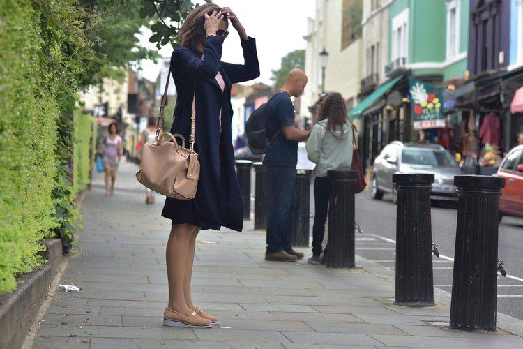 Marks & Spencer trench coat, Marks & Spencer knit top, Karen Millen bag, River Island shoes, Notting Hill, Portobello Road, London. Image©sourcingstyle.com
