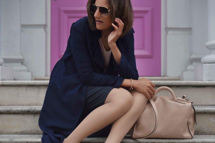 Marks & Spencer trench coat, Marks & Spencer knit top, Karen Millen bag, Notting Hill, London. Image©sourcingstyle.com