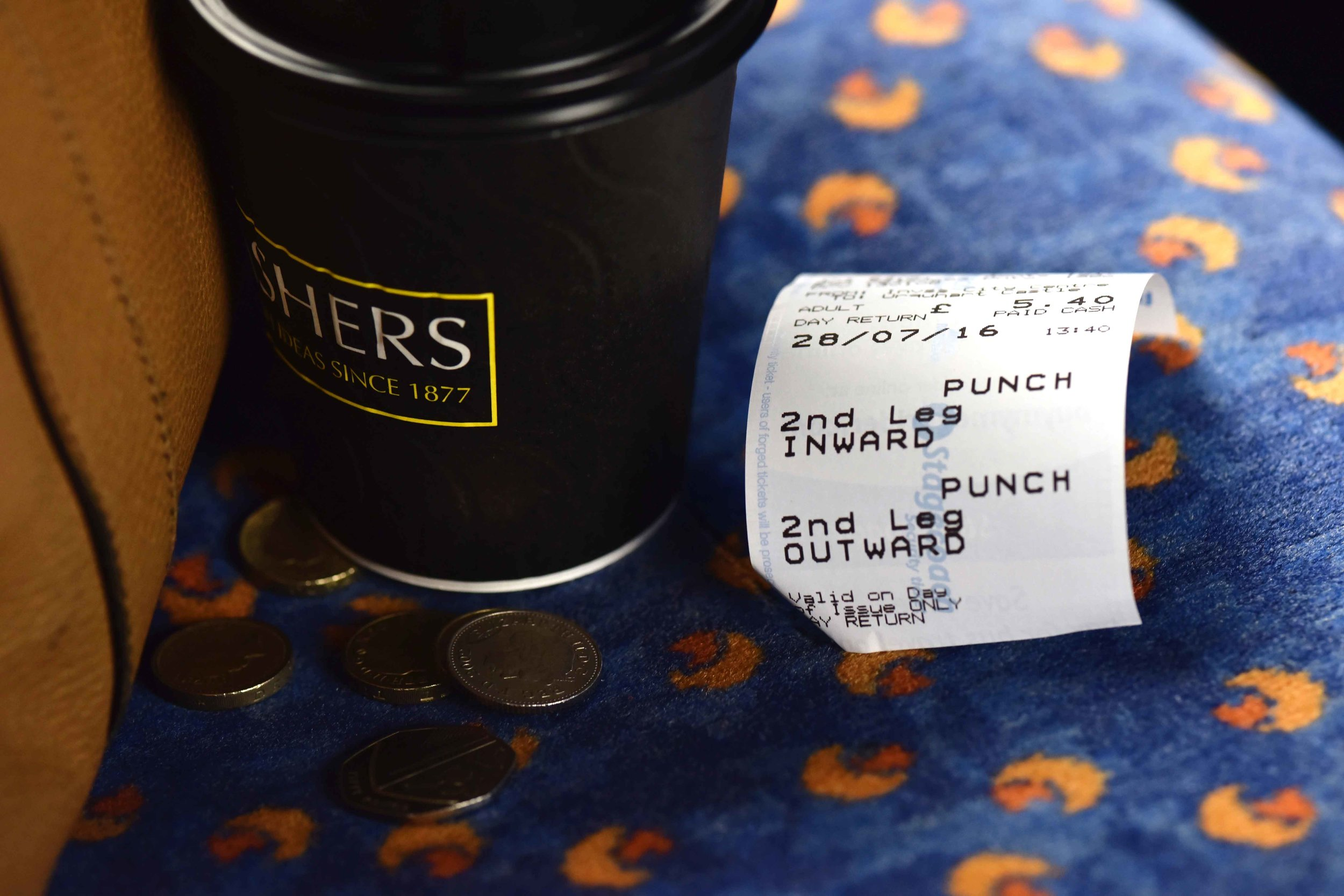 Takeaway coffee in bus, Inverness to Lochness, Scotland. Image©sourcingstyle.com