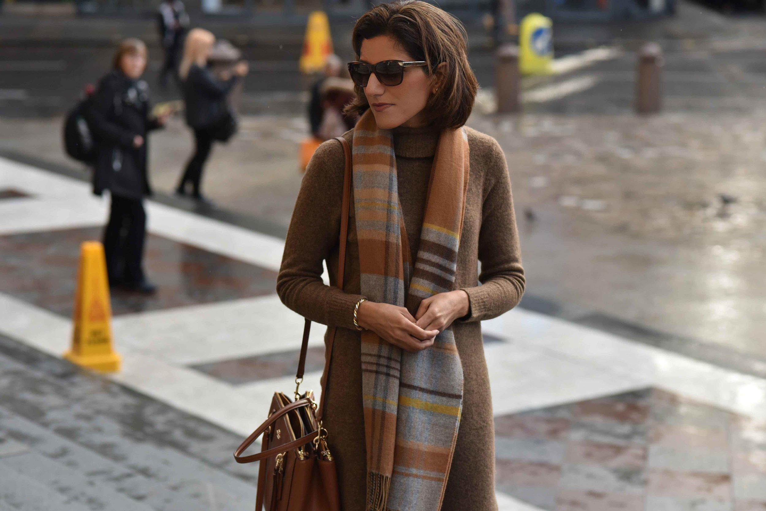 Marks & Spencer sweater dress, Marks & Spencer plaid scarf, Coach handbag, Gucci sunglasses. Photo: Alizeh Latif. Image©sourcingstyle.com.
