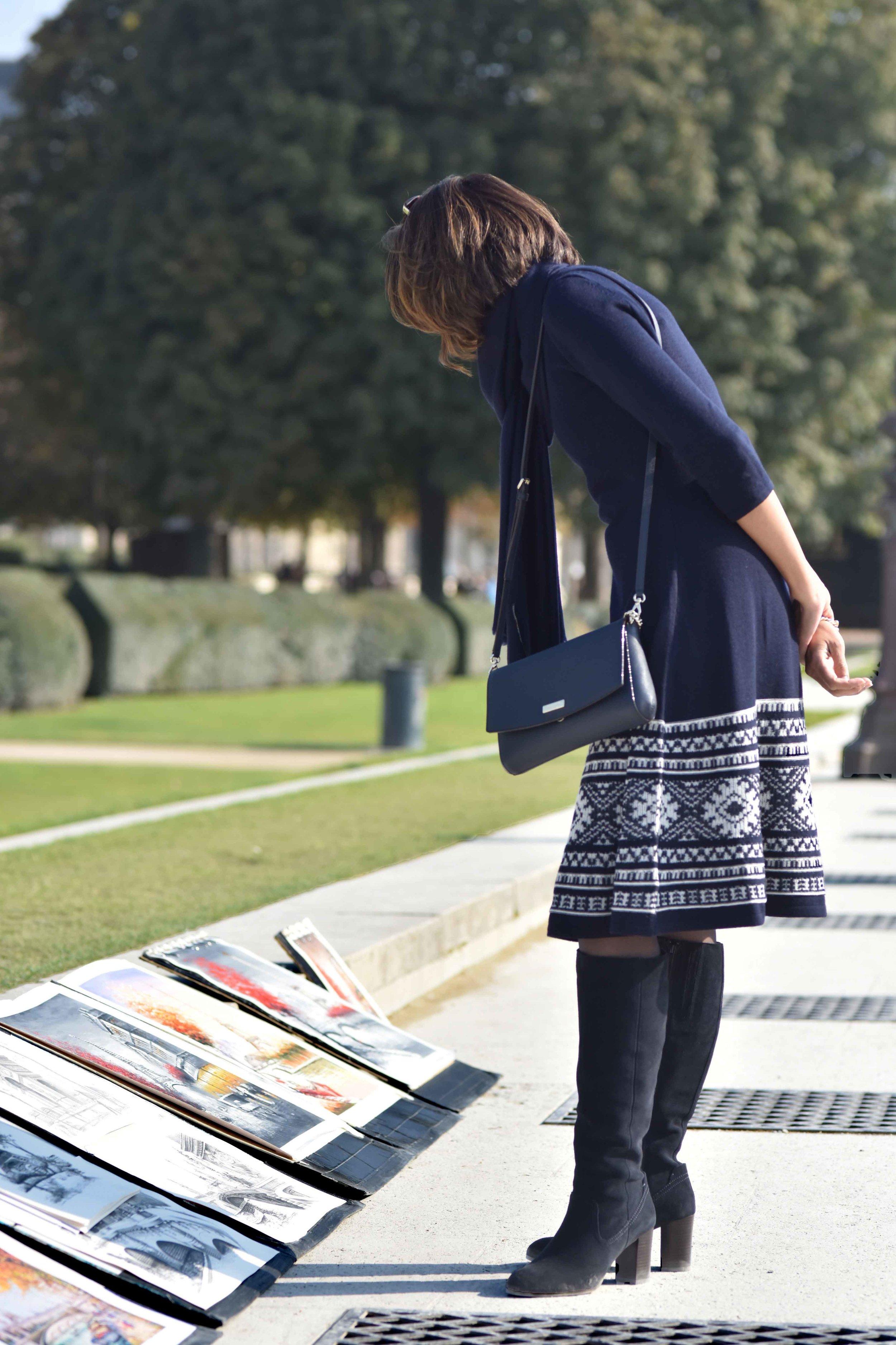 Ralph Lauren woolen jersey knit dress, Marks & Spencer knee high boots, Kate Spade sling bag, Jardin de Tuileries, Paris. Photo: Nina Shaw. Image©sourcingstyle.com