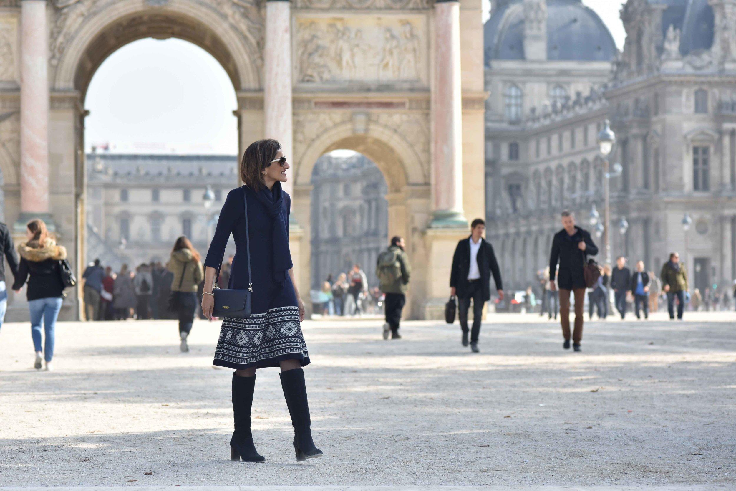 Ralph Lauren woolen jersey knit dress, Marks & Spencer knee high boots, Kate Spade sling bag, Le Louvre, Paris. Photo: Nina Shaw. Image©sourcingstyle.com