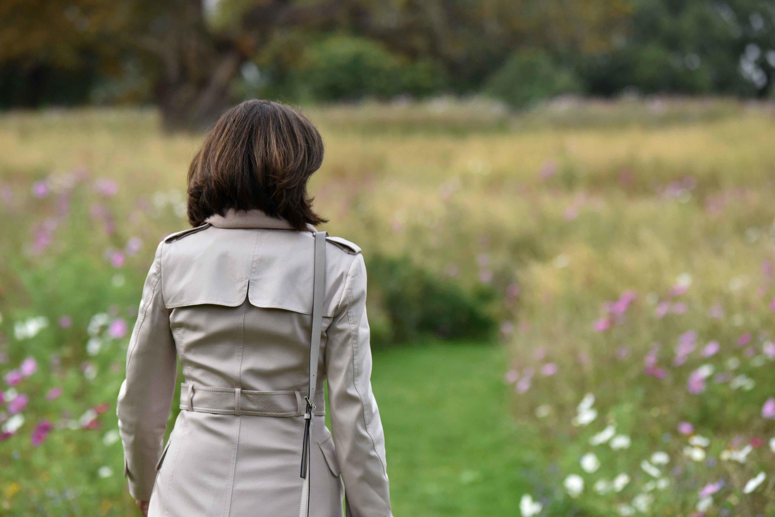 Karen Millen trench jacket, flower fields, Coworth Park hotel, Ascot. Image©sourcingstyle.com