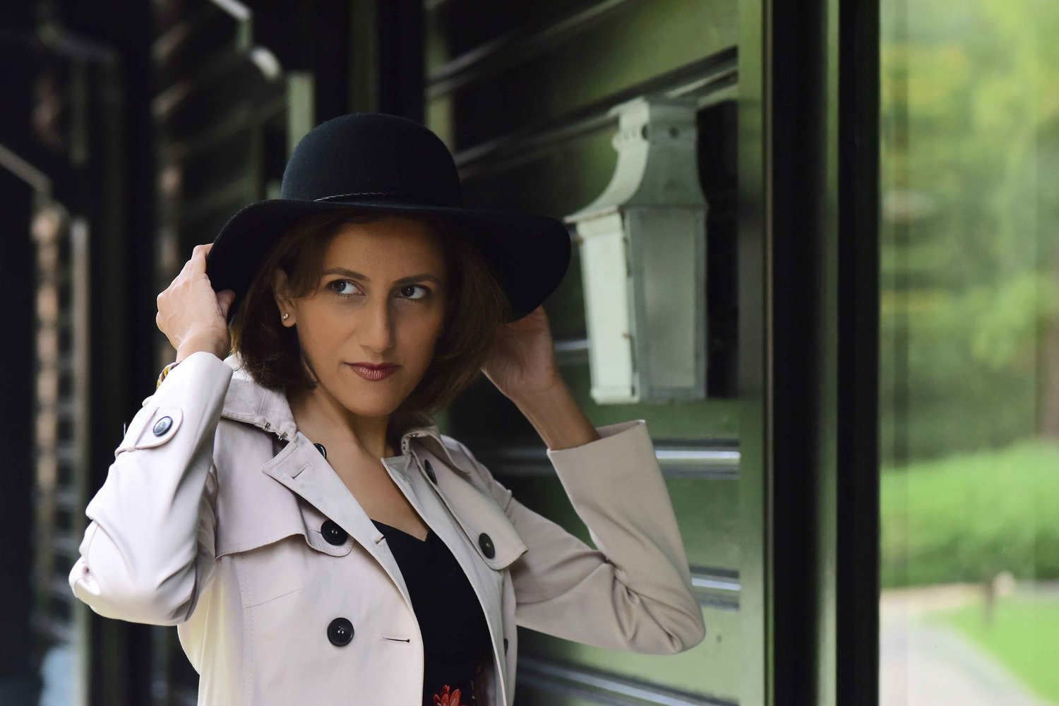 In a Karen Millen trench and dress, Coworth Park Hotel & Spa, London, U.K. Image©sourcingstyle.com. Photo: Nina Shaw