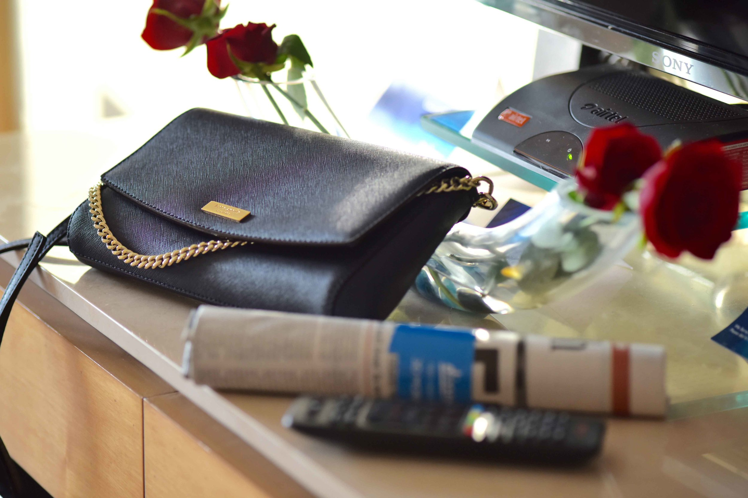 Radisson Blu Hotel, red roses in the room, bag is Kate Spade, Ranchi, Jharkhand, India. Image©sourcingstyle.com.