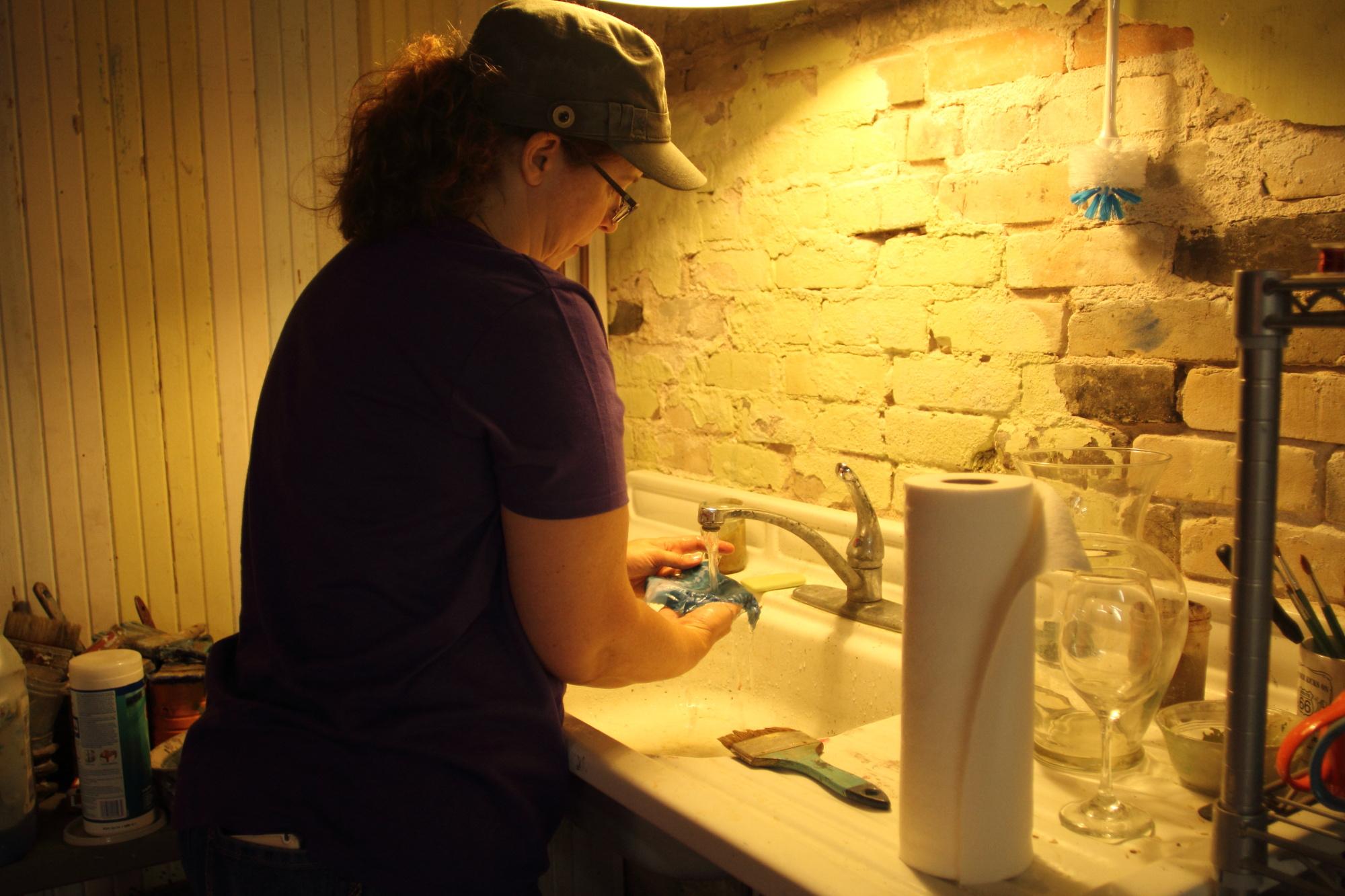 Sally washing out a cyanotype