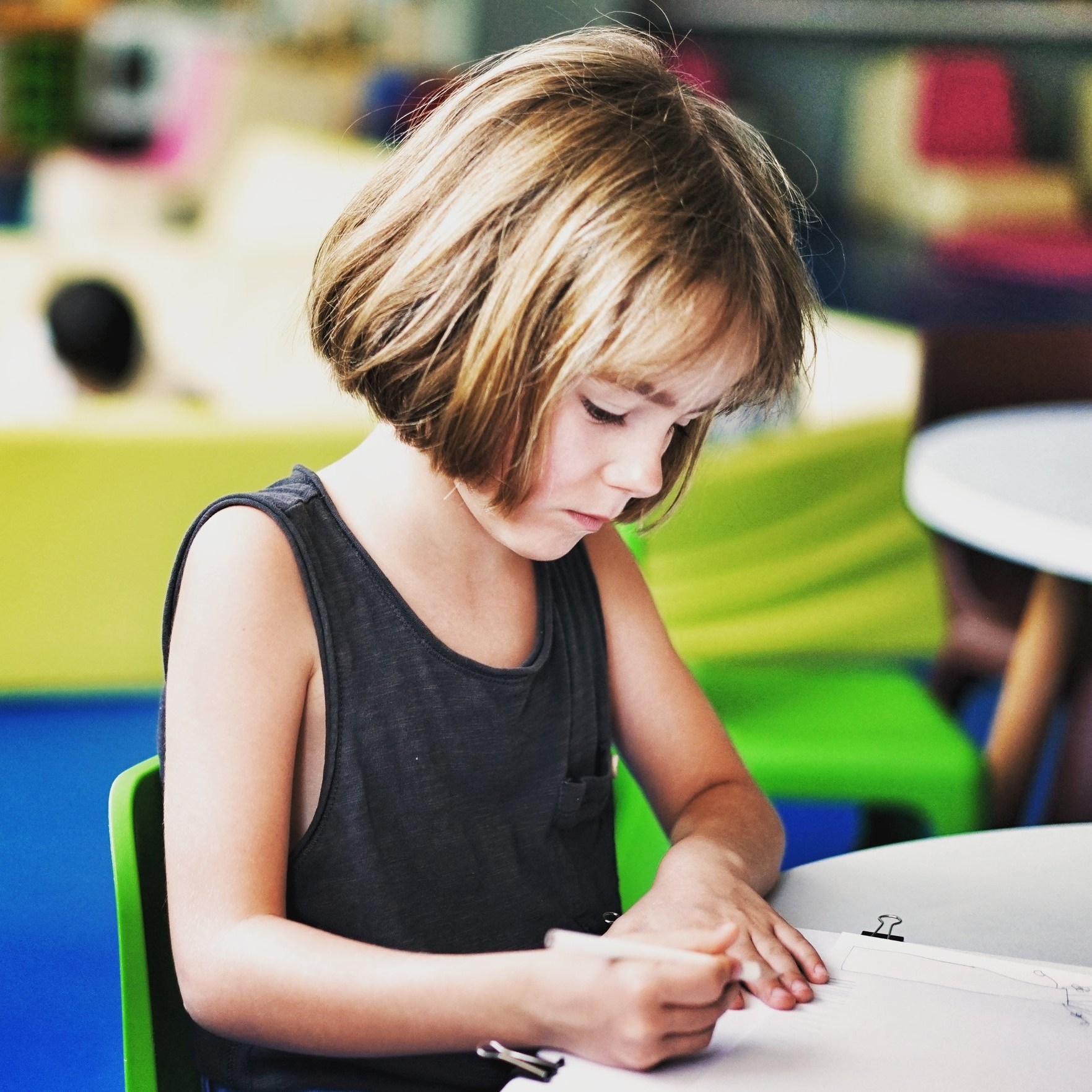 Young girl completing a school worksheet.