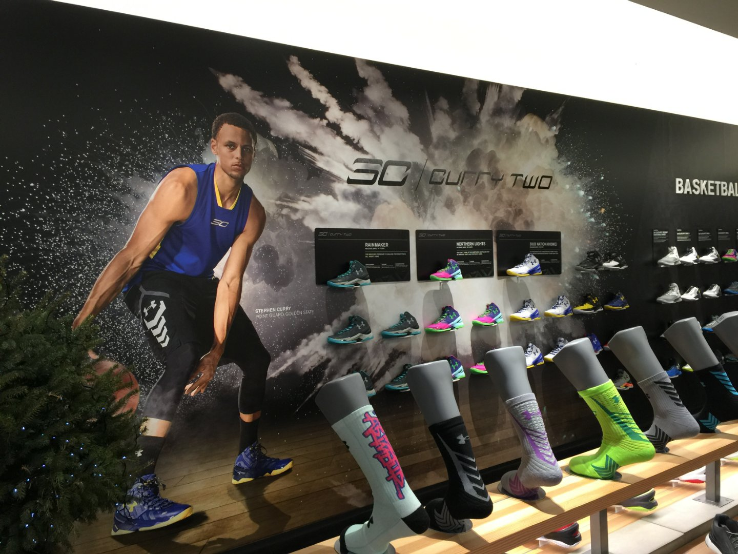 "The Steph Curry shoe display wall, showcasing his ""Curry Two"" basketball shoes in various colorways."