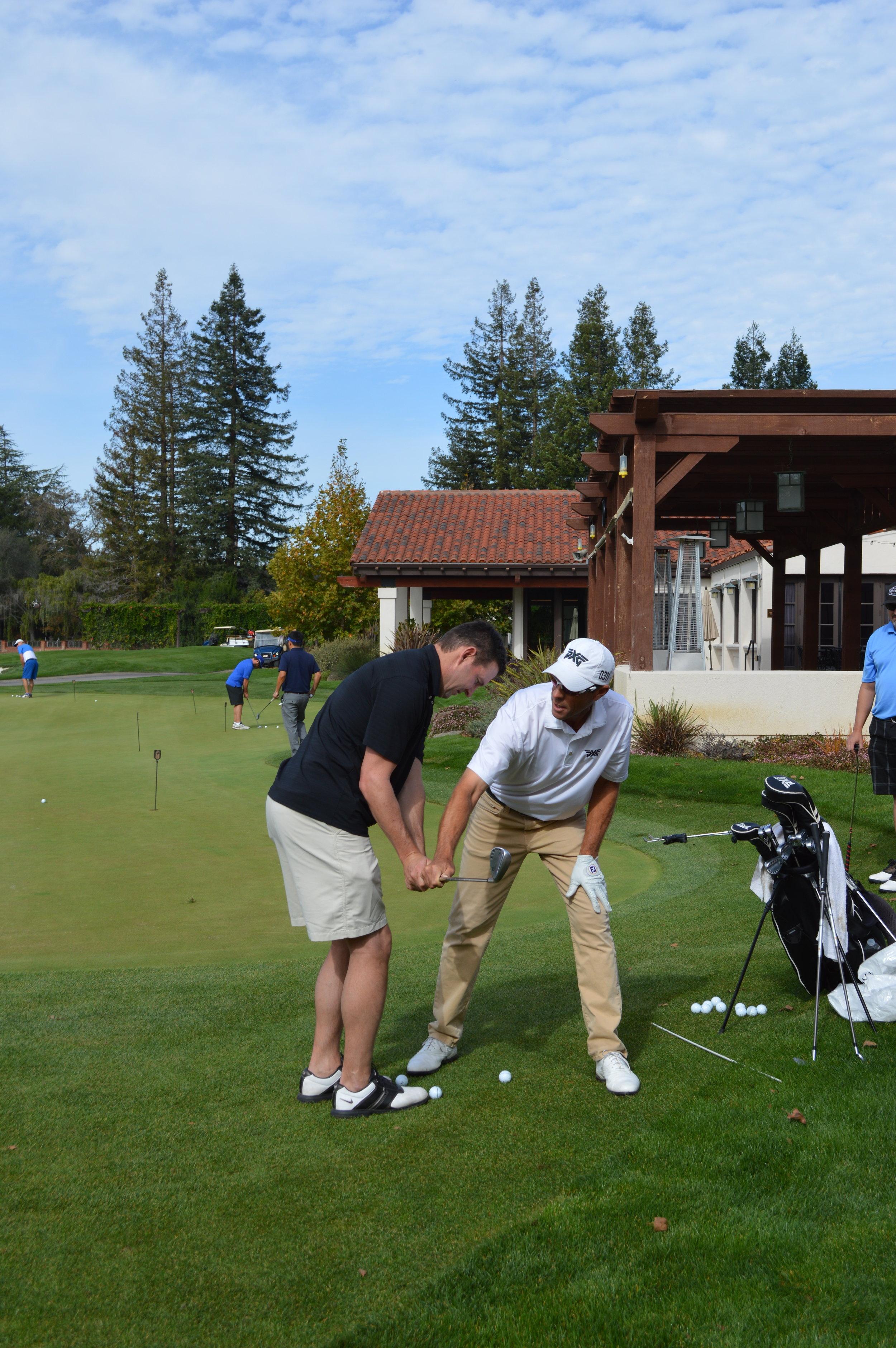 Golf Pro Jeff Brehaut instructing Joe Cannon