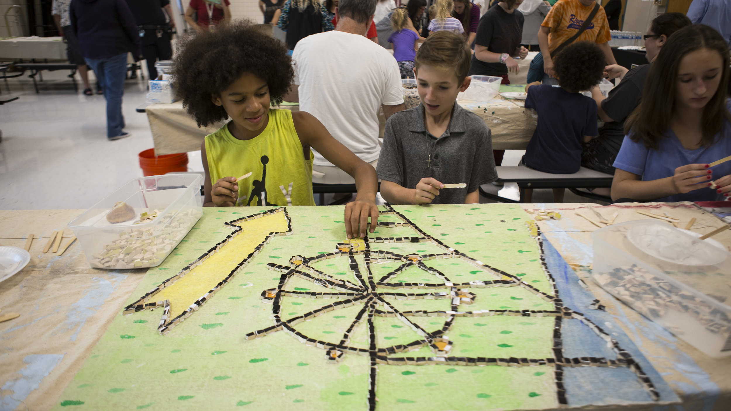 Riverview School District students help to put together a collaborative mosaic as part of an Artist-in-Residence program put on by Pittsburgh Filmmakers/Center for the Arts.