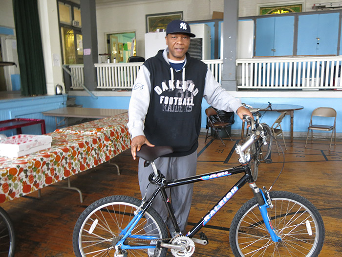 A participant shows his newly repaired bike at the Bike-Friendly Kingston free bike repair at the Repair Cafe.