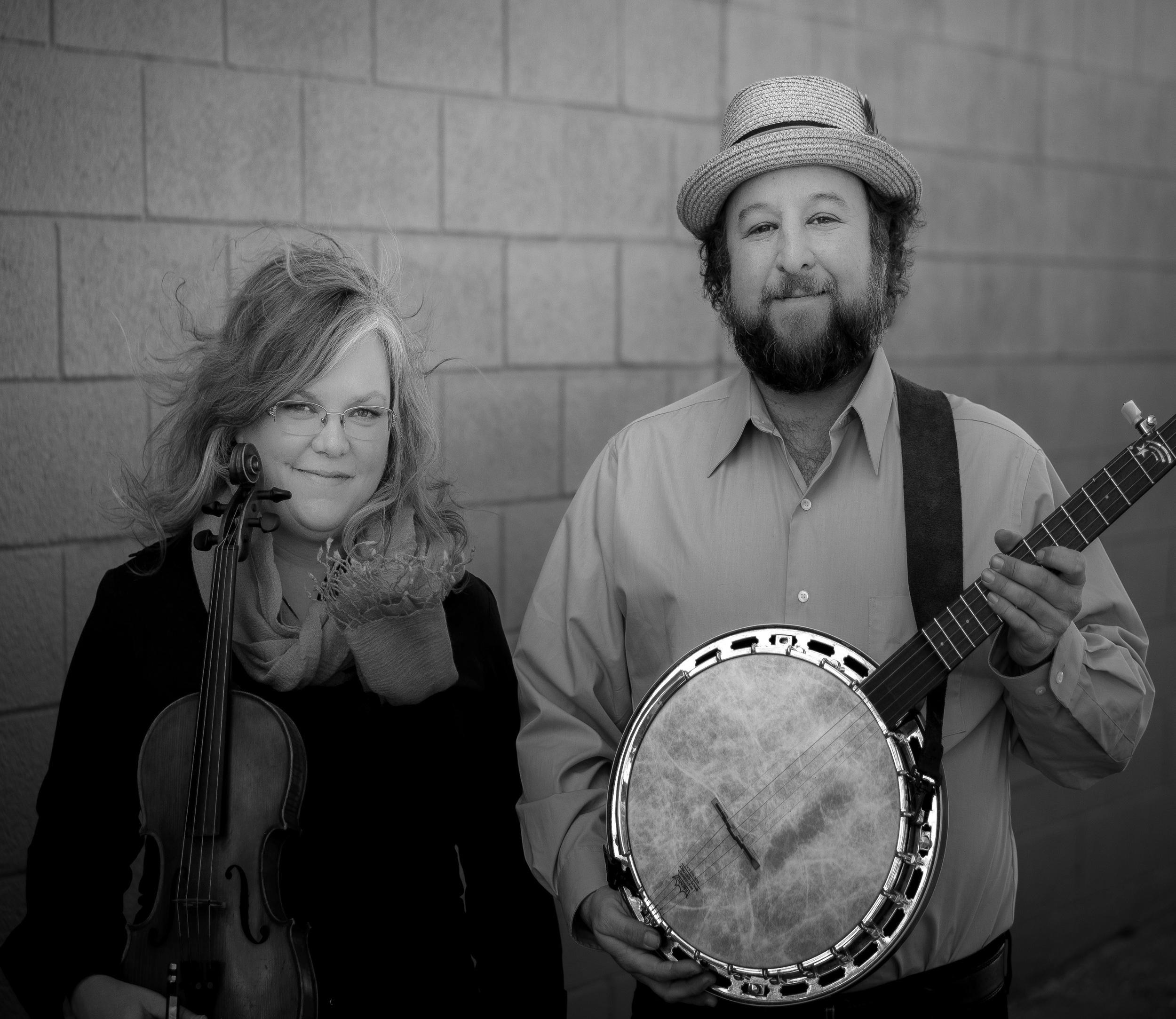 Betse & Clarke with instruments promotional photograph, B/W. Photo credit: Clarke Wyatt