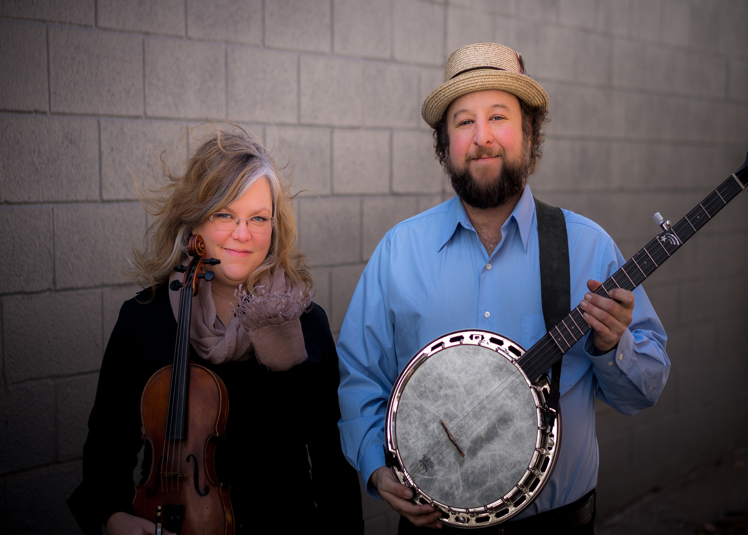 Betse & Clarke with instruments promotional photograph, color. Photo credit: Clarke Wyatt