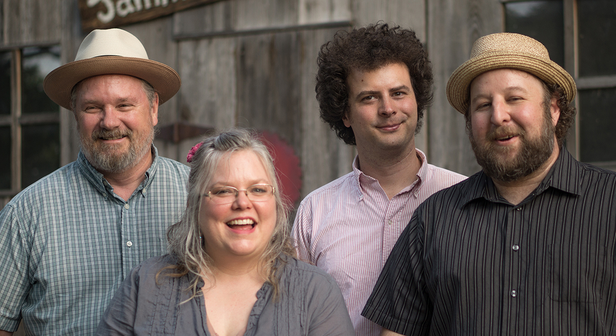 Left to right: Brett Hodges (guitar, mandolin, fiddle, vocals); Betse Ellis (fiddles, vocals); Alex Mallett (bass, banjo, vocals); Clarke Wyatt (banjos)