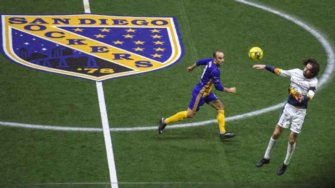 Landon Donovan, left, battles with Cory Keitz of the Tacoma Stars. Robert Beck for ESPN