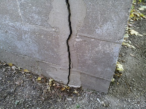 Here's a nasty looking foundation crack at the corner of this house