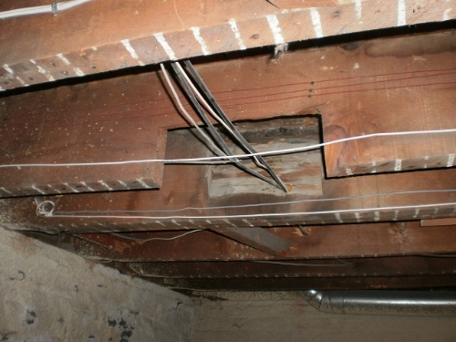 They probably didn't need to butcher that joist for the wiring!