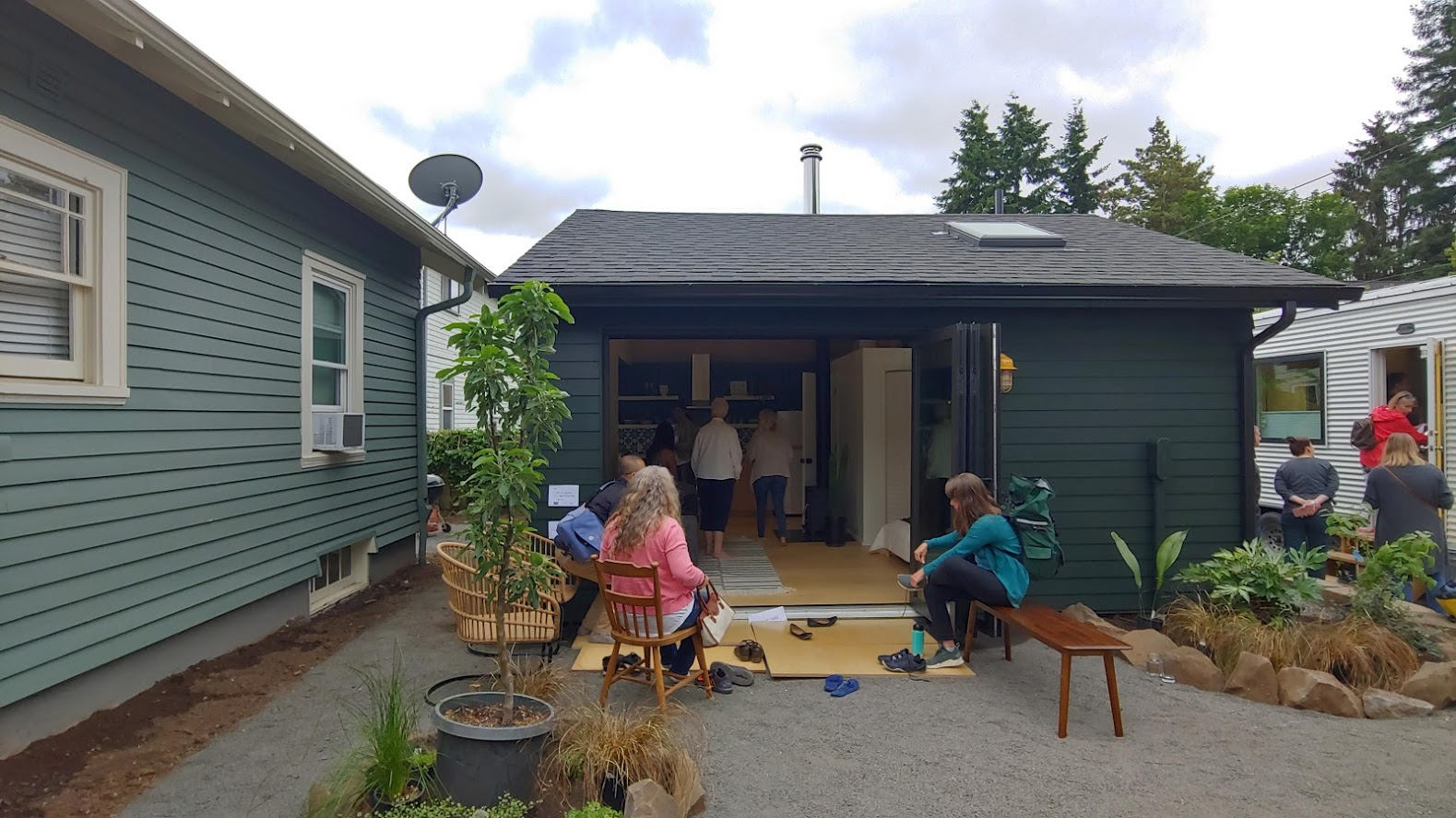 A different world in the backyard! There is a detached unit in the backyard (middle), and another tiny house on the right. 3 units in 1! Owner lives in the middle while renting out the main house. Tiny house is an Airbnb. Party central! Builder: Sprucebox Construction