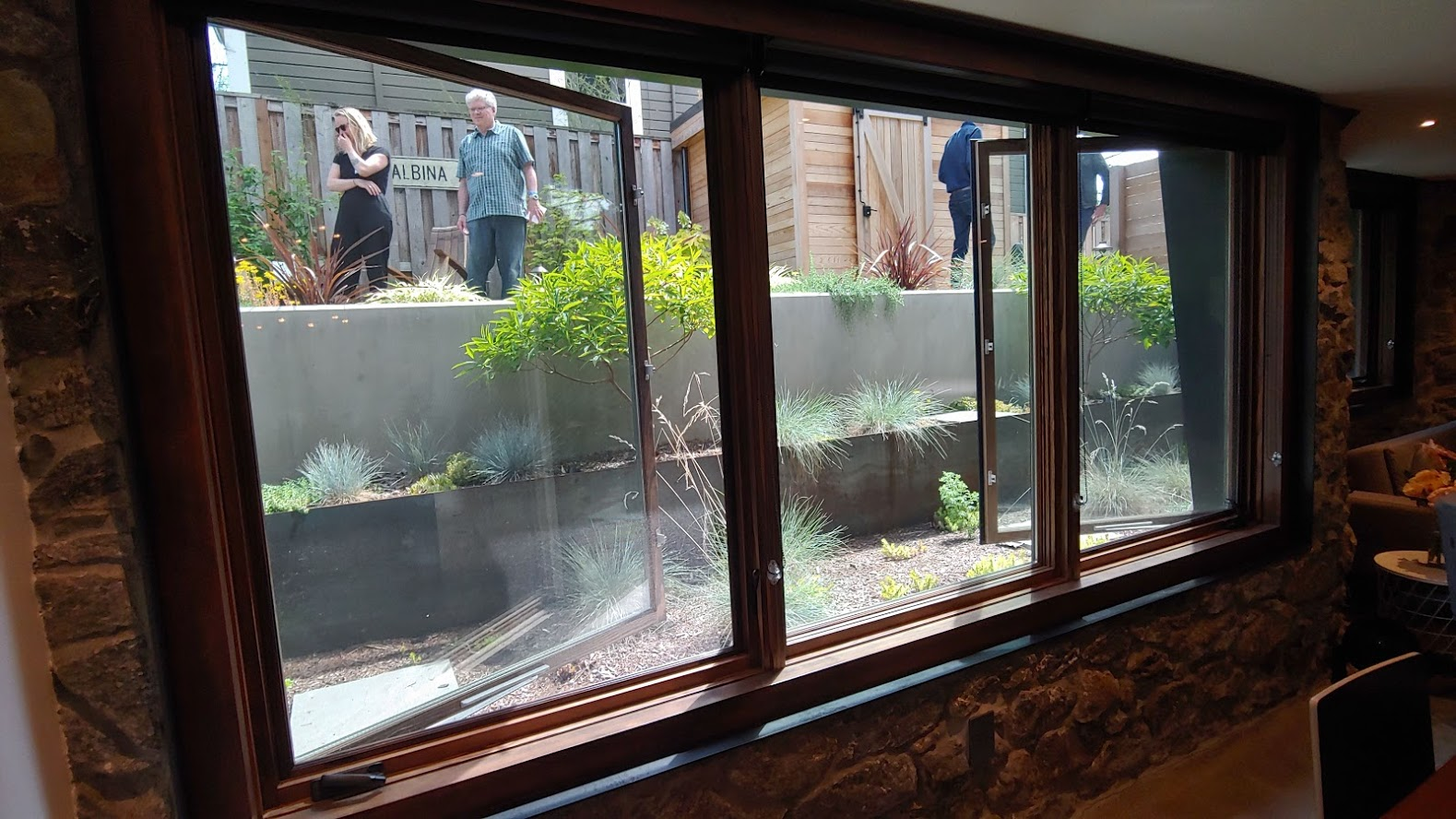 This basement window is approx. 8 feet wide x 4 feet high. With some expensive landscaping work outside. Not only does this meet escape and lighting needs, it also creates a space that feels nothing like a basement suite.
