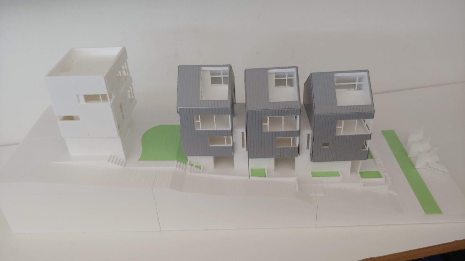 Here's a model of 4 new houses that were constructed on what was a single family lot approx. 50' x 160'. Only 1 parking space is required for each house.