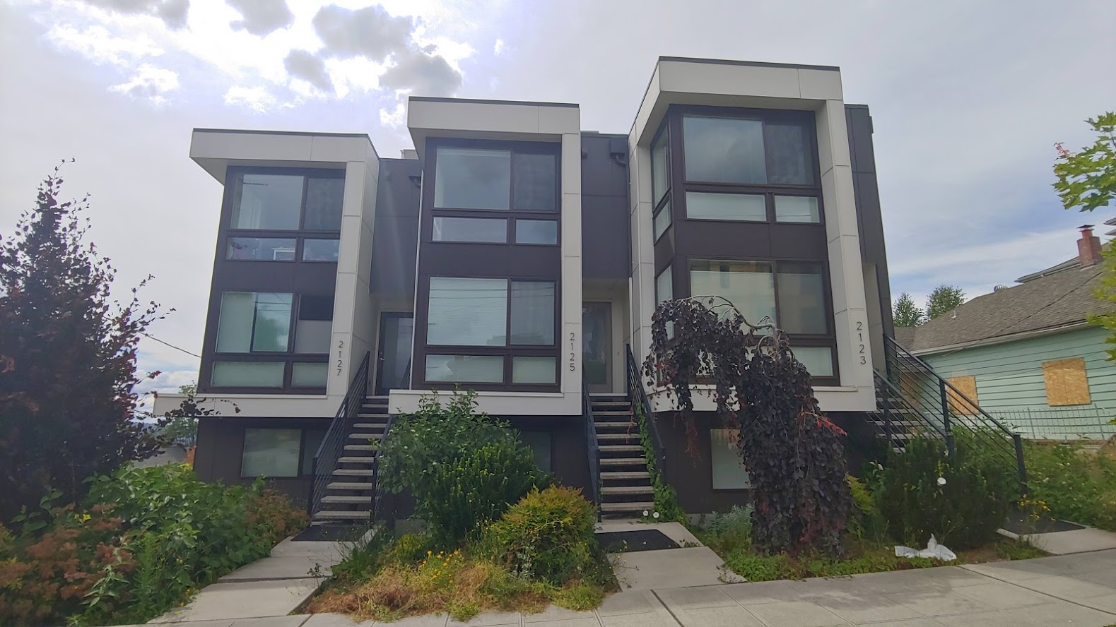 "3 Townhouses on a single family lot. Lower level usually has a ""flex space"" with studio apartment with kitchenette that can be used by family members or rented out through Airbnb."