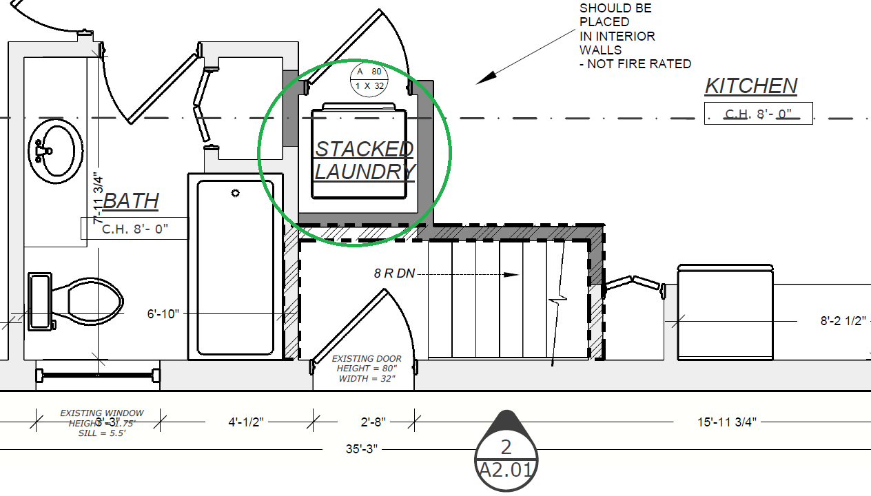 Sample common stacked laundry arrangement where stairs leading to main unit previously resided