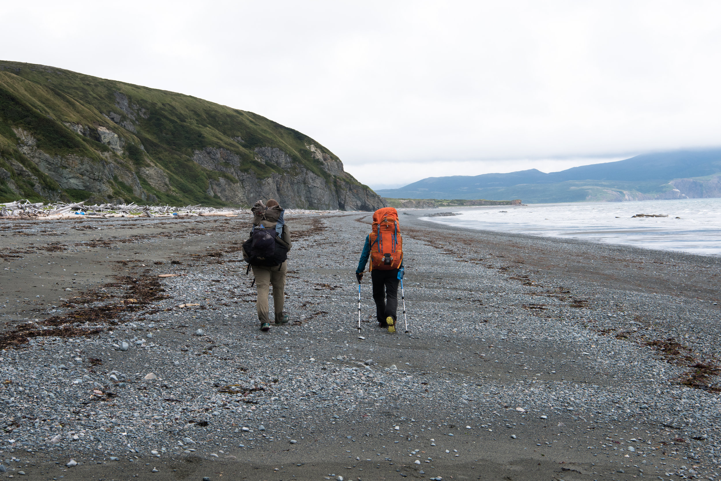 Rachel James and Erin McKittrick walk north along the Amakdedori Beach to the proposed industrial complex and port site on the western shores of Cook Inlet. Photo by Jayme Dittmar