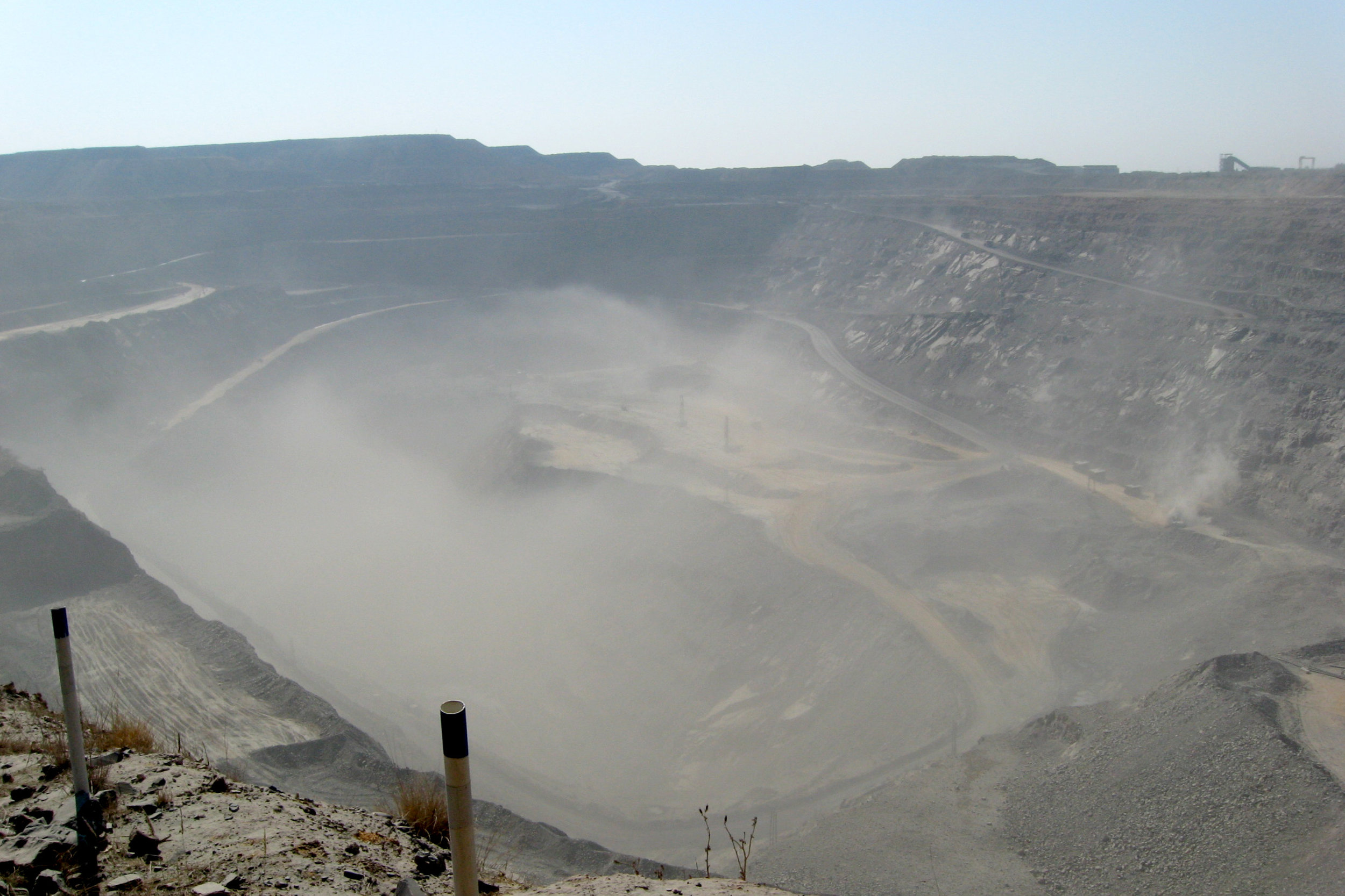 Example of dust swirling at an open pit mine in Botswana