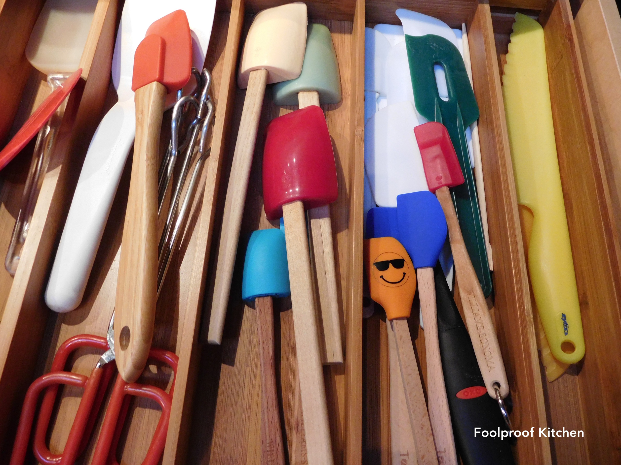 Drawer full of spatulas.  I have a soft spot for smiling objects in my kitchen!