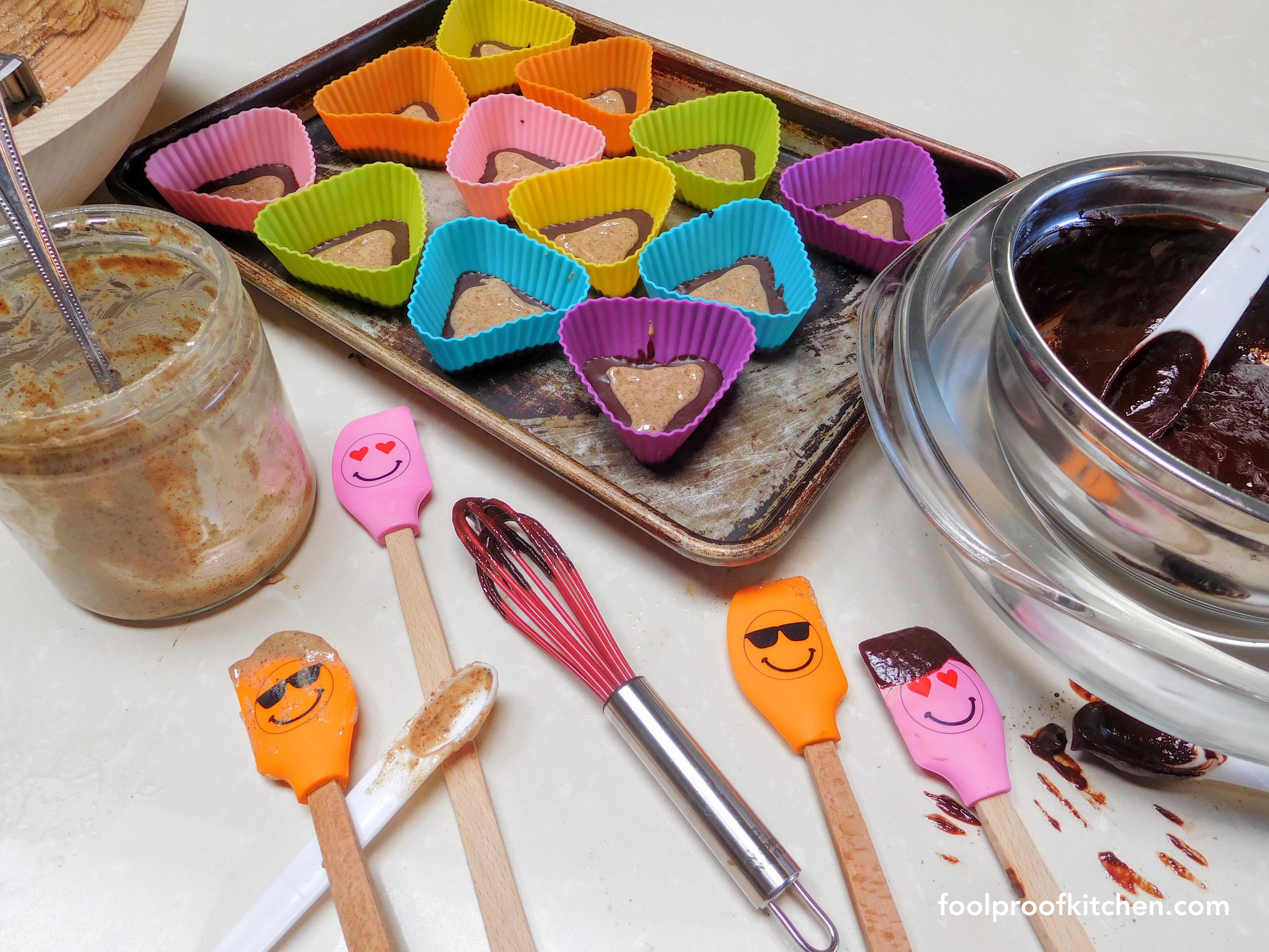 Making raw cacao chocolates with homemade organic almond butter on Vday. The spatulas had a double date.