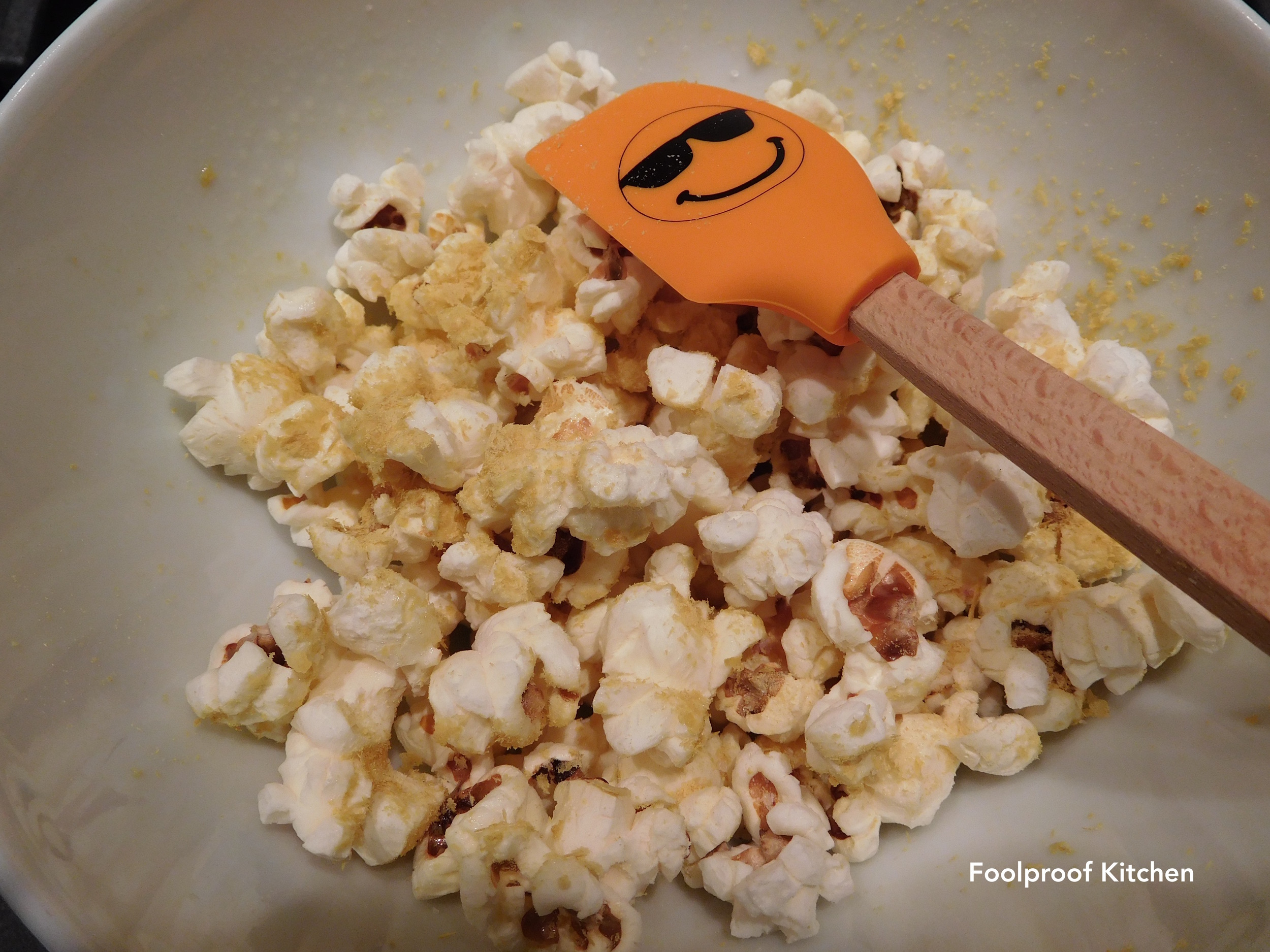 Popcorn with salt and nutritional yeast, and a smiling spatula, of course.