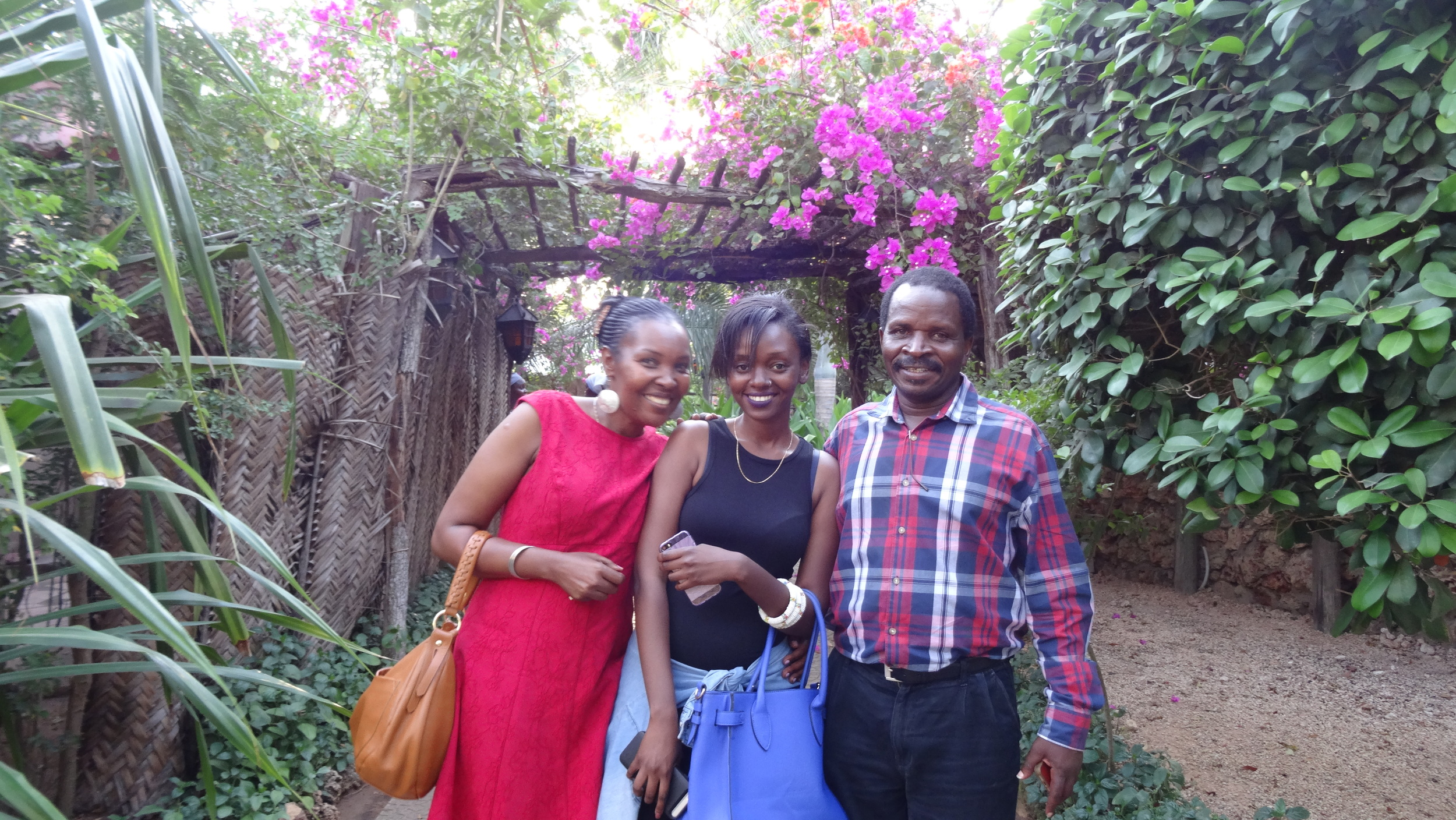 Caroline (middle), her father Mr. Kyabukoba and his wife.