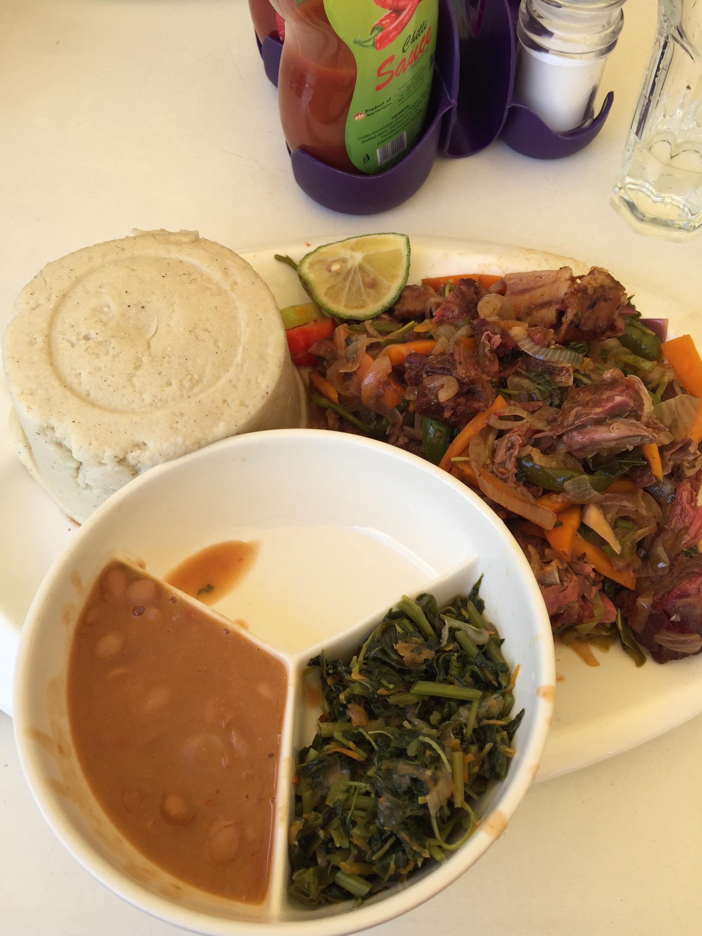 Goat with veggies, beans, greens + ugali (maze = carbs)
