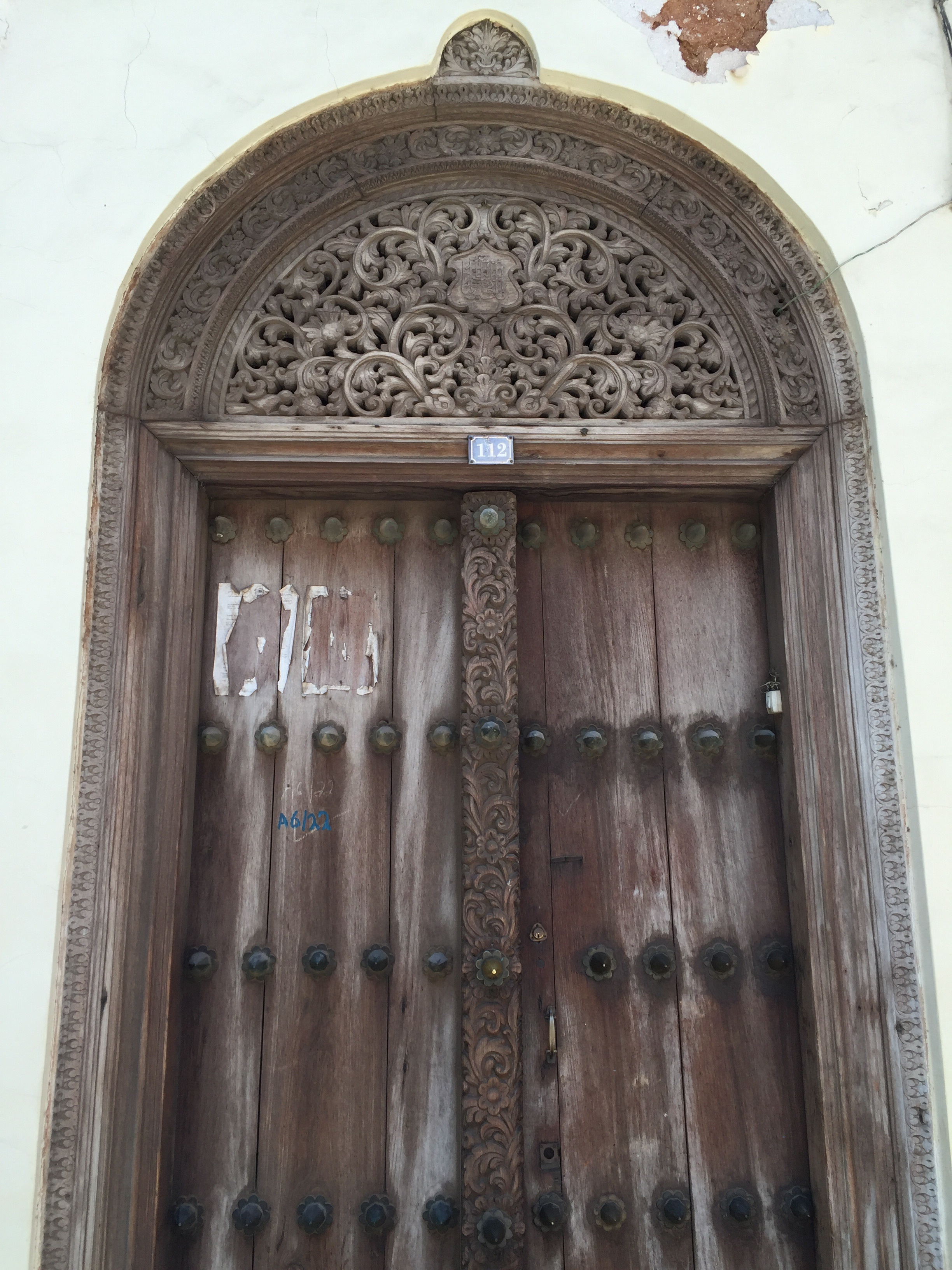Sun washed door. Besides their beaches and picturesque sunsets, Zanzibar is well known for their uniquely design doors.
