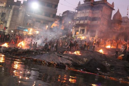 """A picture of  Manikarnika Ghat, """"Burning Ghat"""". It's one of two cremation locations in Varanasi. I choose this picture because it shows the different hierarchies of the caste system, even in death.  *Picture taken from google images because you're not suppose to take pictures while observing the cremations."""