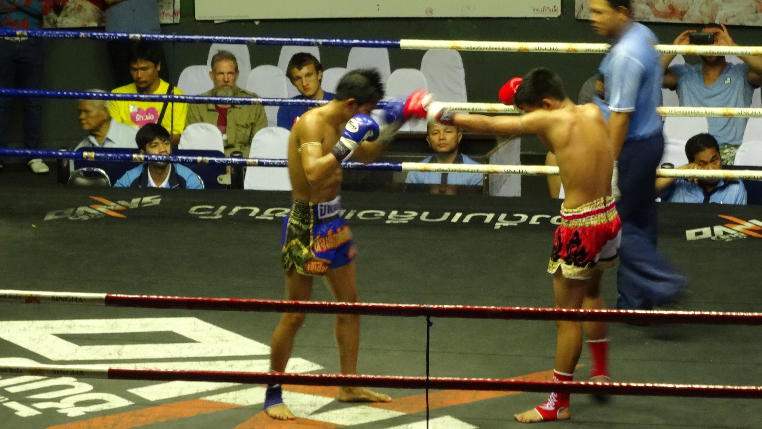 Muay Thai  fight at Rajadmnern Stadium. Thailand's number 1 sport. It appears to be more about the gambling than the fighting, which is still cool to see. Not taking anything away from the fighters, it's just there's a lot of betting.